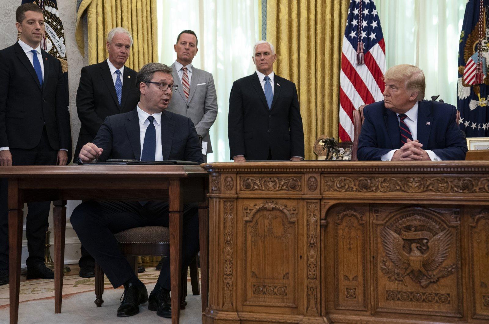 President Donald Trump listens to Serbian President Aleksandar Vucic speak during a signing ceremony with Kosovar Prime Minister Avdullah Hoti at the White House, Washington, Friday, Sept. 4, 2020. (AP Photo)