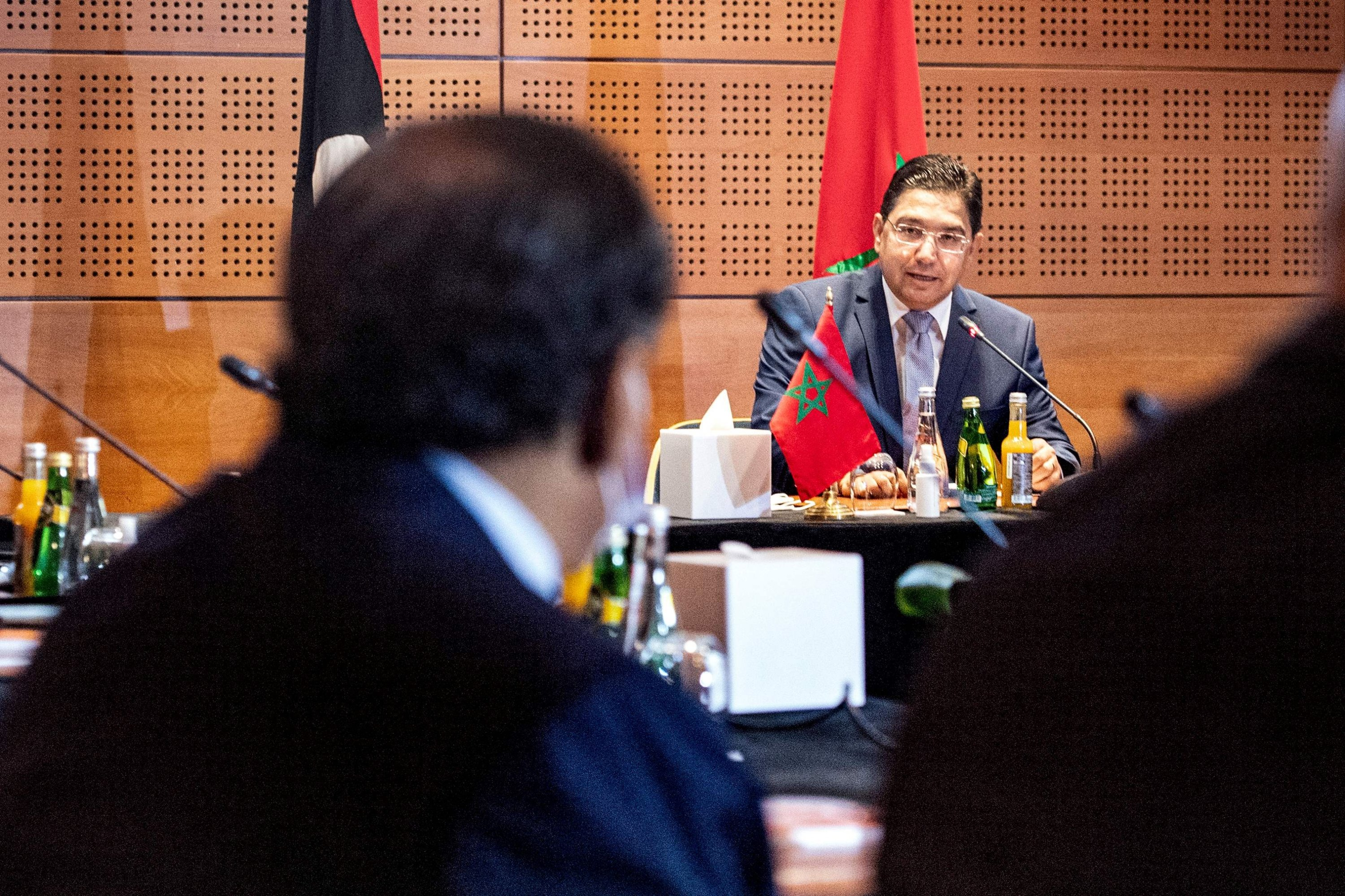 Nasser Bourita (C), Morocco's Minister of Foreign Affairs and International Cooperation, chairs a meeting of representatives of Libya's warring parties in the coastal town of Bouznika, Sept. 6, 2020. (AFP Photo)
