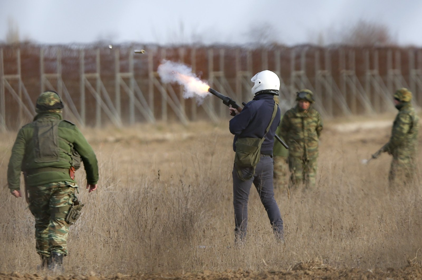 Members of the Greek military fire tear gas canisters during clashes between migrants and Greek police and army personnel near the Kastanies border gate at the Greek-Turkish border, March 1, 2020. (AP Photo)