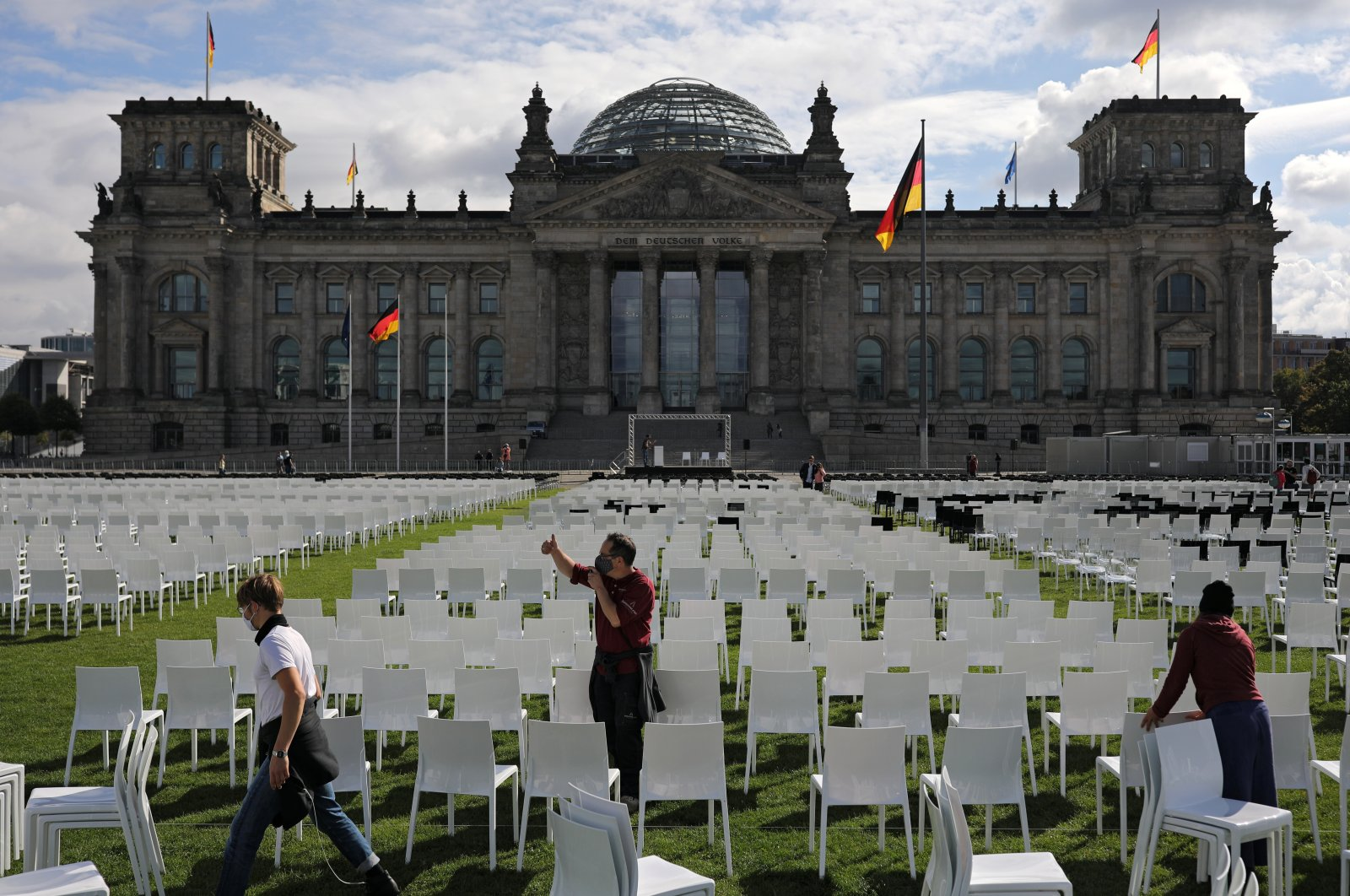 Activists set up empty chairs for a protest demanding the evacuation of Greek migrant camps, in front of the Reichstag building in Berlin, Germany, September 7, 2020. (Reuters Photo)