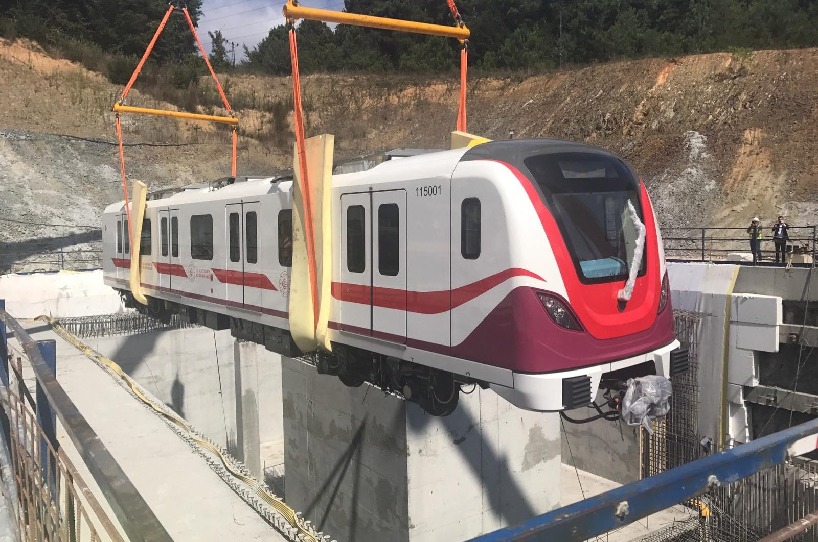 The first subway car is laid on the tracks of the Gayrettepe-Istanbul Airport metro line, Istanbul, Turkey, Sept. 6, 2020. (AA Photo)