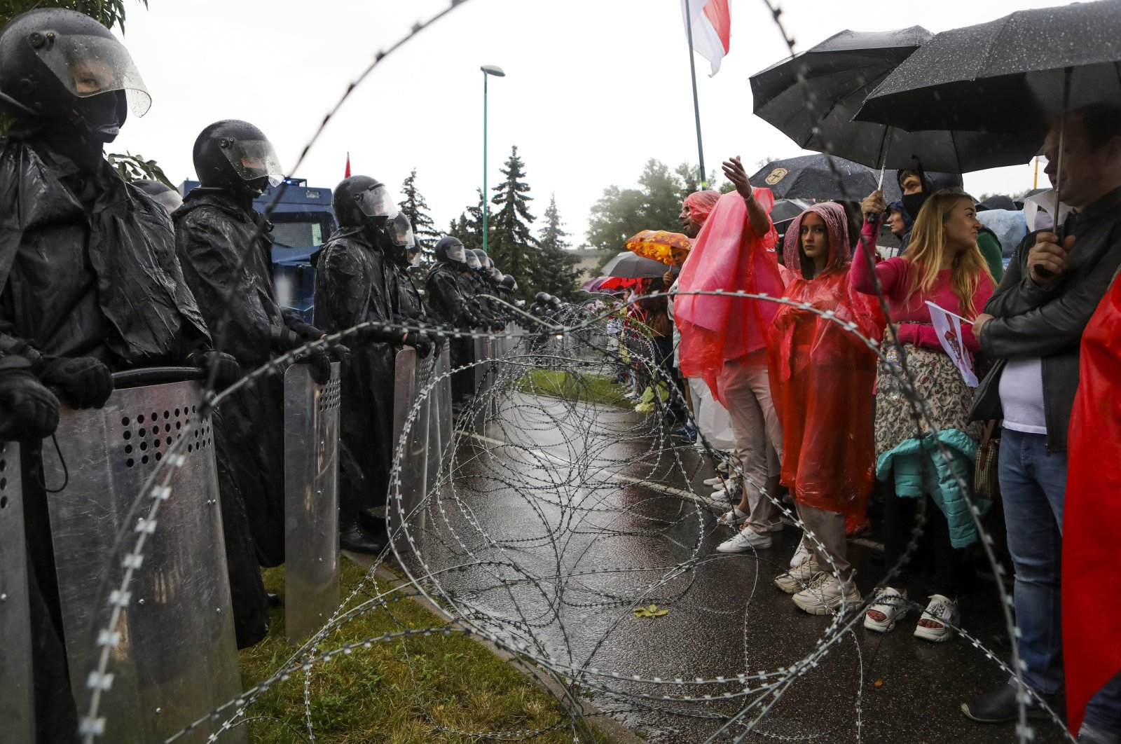 Protesters argue with police standing in front of a police barricade, Minsk, Sept. 6, 2020. (AP Photo)