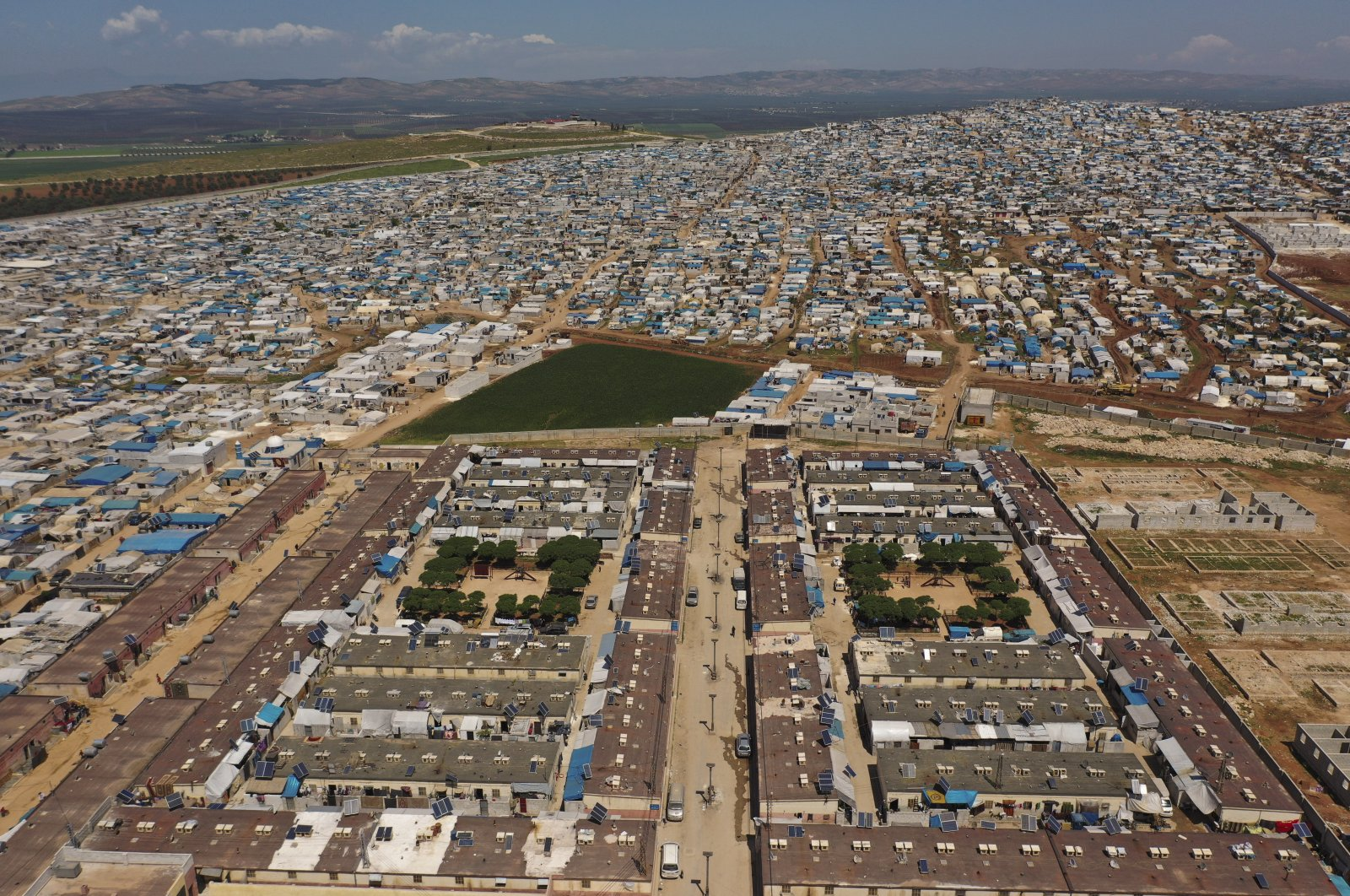 A large refugee camp pictured on the Syrian side of the border with Turkey, near the town of Atma, in Idlib province, Syria on April 19, 2020. (AP File Photo)