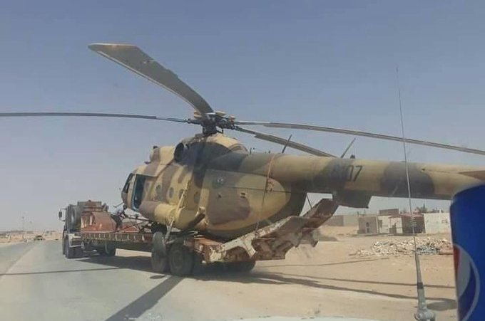 GNA forces carry the helicopter away from the spot where it landed in Libya's Abu Grein area, Sept. 7, 2020. (Photo from Facebook)
