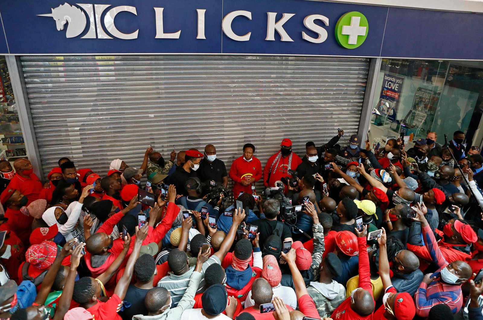 Economic Freedom Fighters (EFF) leader Julius Malema (C) addresses his supporters during a picket outside Clicks Store at the Mall of the North in Polokwane, Sept. 7, 2020. (AFP Photo)