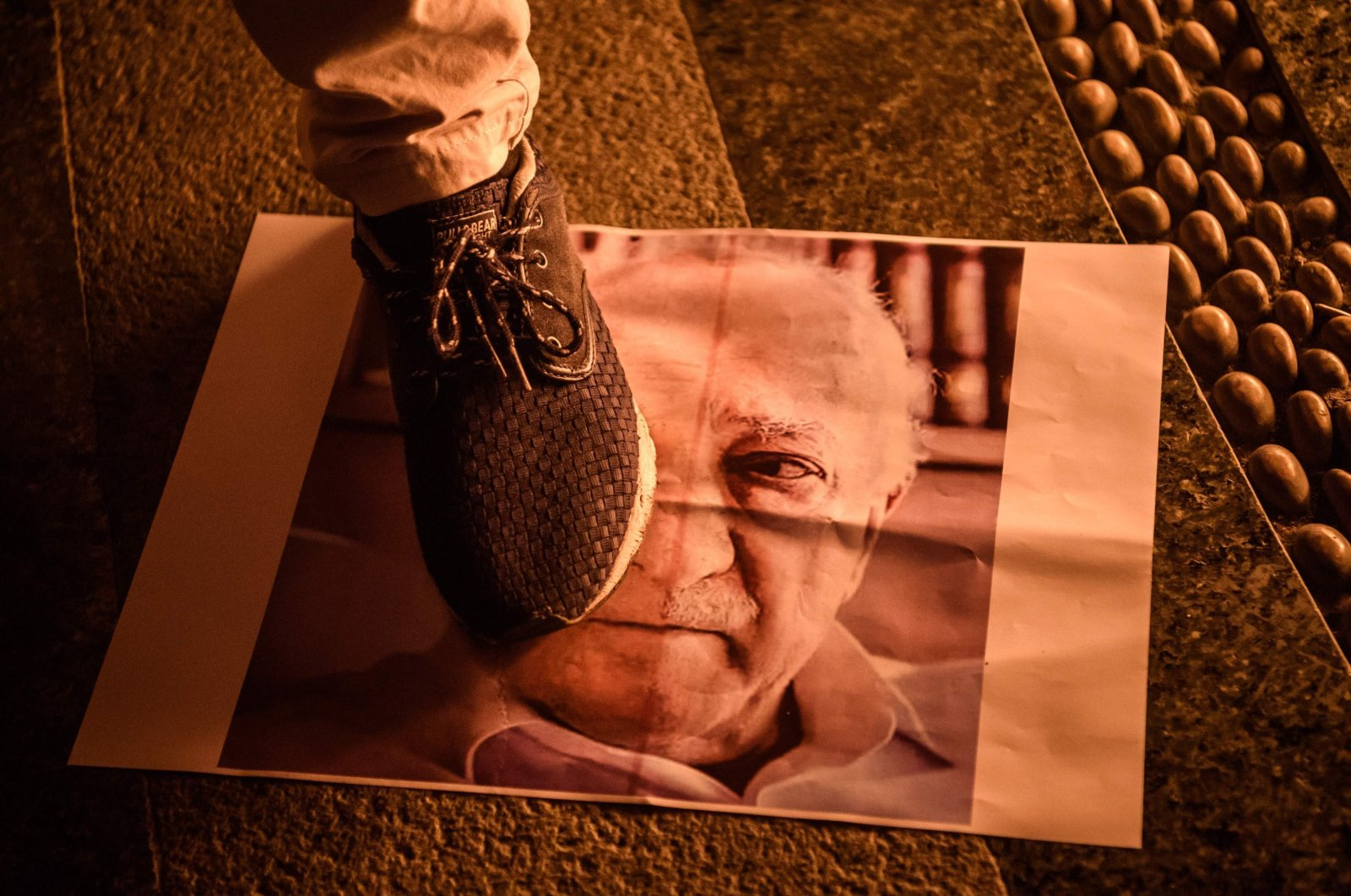 A man steps on a poster of FETÖ leader Fetullah Gülen during a rally to protest the group's coup attempt, in Istanbul, Turkey, July 18, 2016. (AFP Photo)