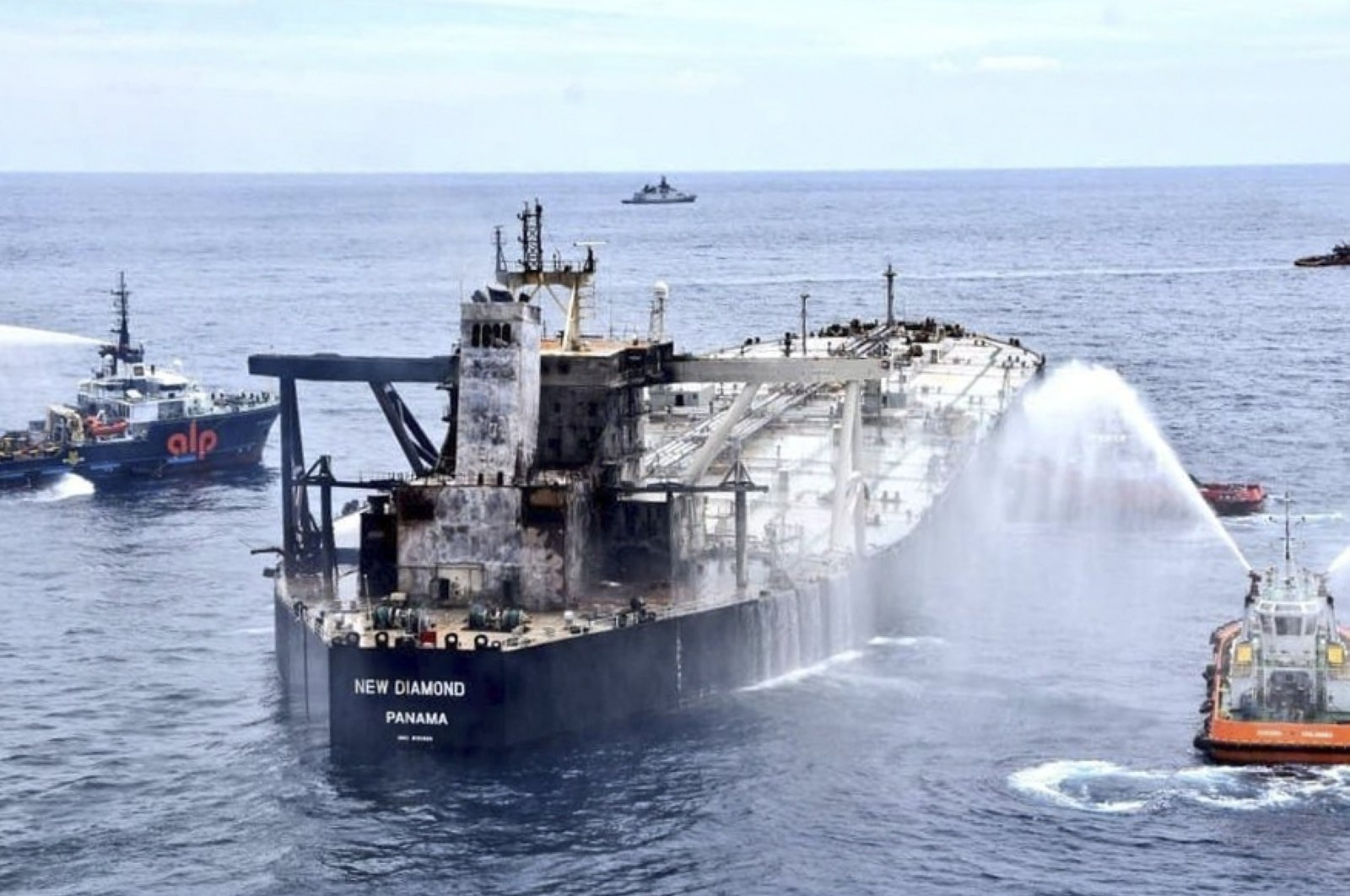 This handout photograph taken on Sept. 6, 2020, and released by Sri Lanka's Air Force shows the Panamanian-registered crude oil tanker New Diamond after a fire aboard was extinguished, some 60 kilometers off Sri Lanka's eastern coast where a fire was reported inside the engine room. (Sri Lanka's Air Force Photo via AFP)