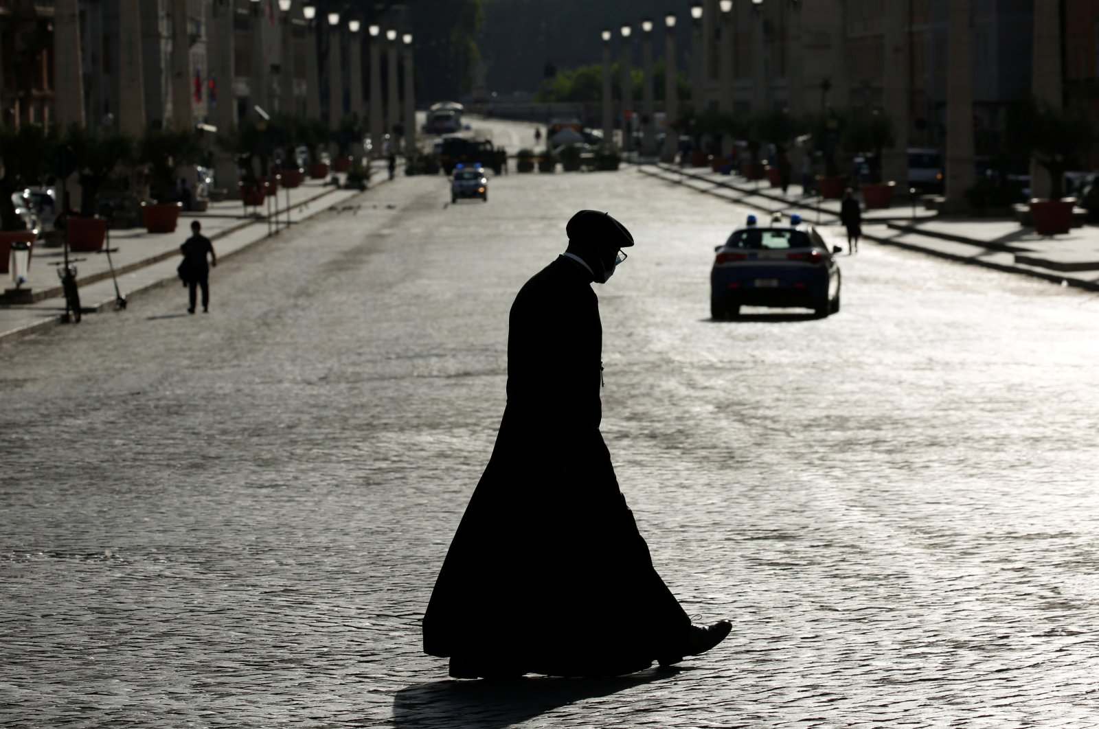 A priest is silhouetted along Via della Conciliazione street, near Vatican City, at the first weekly general audience led by Pope Francis, open to the public for the first time since the global outbreak of COVID-19, in Rome, Italy, Sept. 2, 2020. (Reuters Photo)