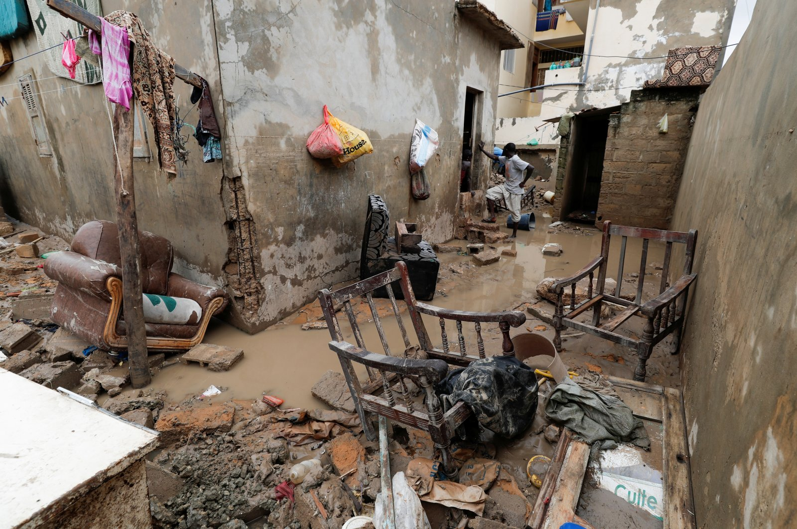 A man stands at a house's flooded courtyard after heavy rains in the Ndiaga Mbaye district on the outskirts of Dakar, Senegal, Sept. 6, 2020. (Reuters Photo)