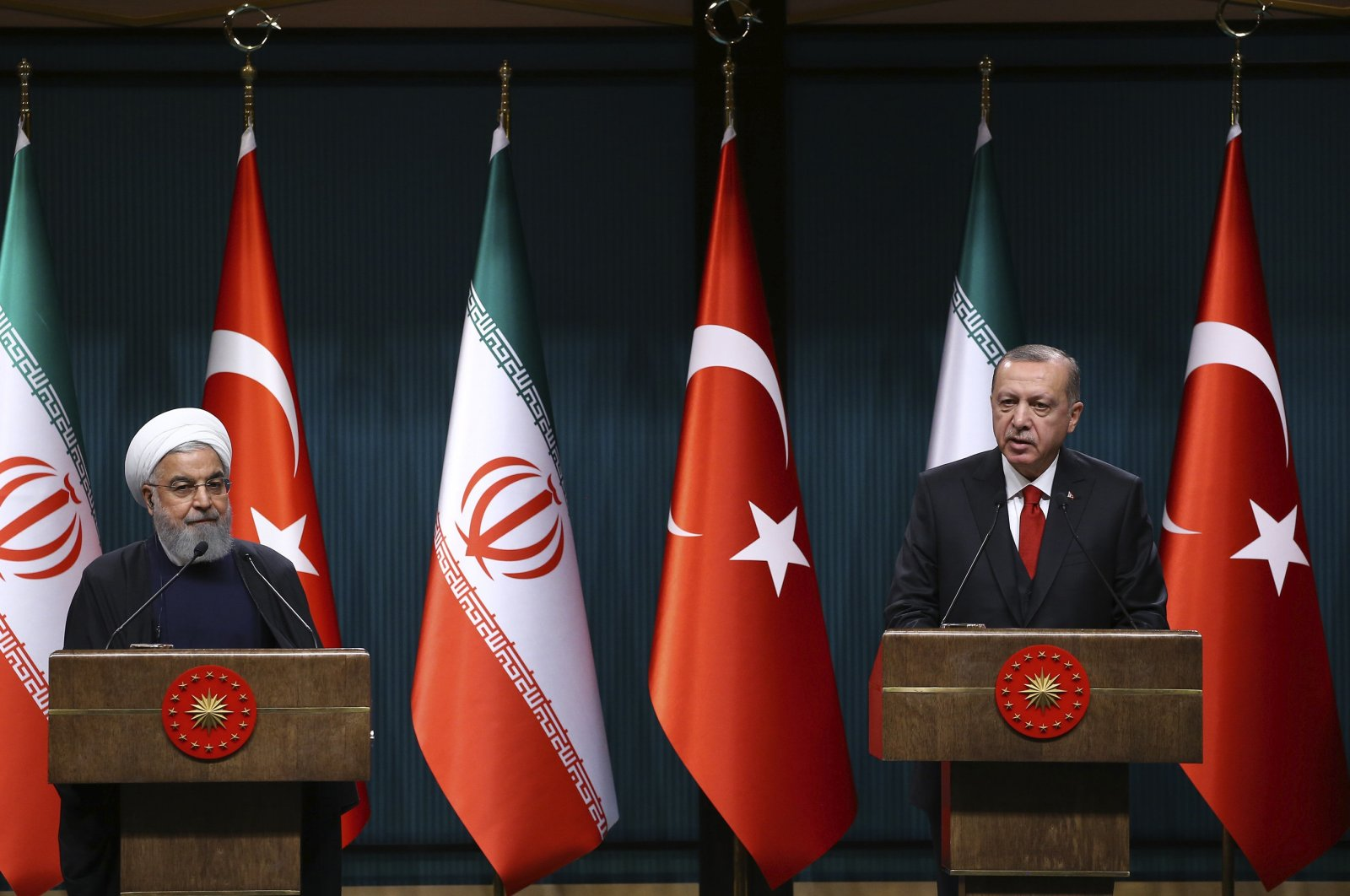 President Recep Tayyip Erdoğan (R) and Iranian President Hassan Rouhani hold a joint news conference following the fifth Turkish-Iranian High-Level Cooperation Council meeting, in Ankara, Turkey, Dec. 21, 2018. (AA Photo)