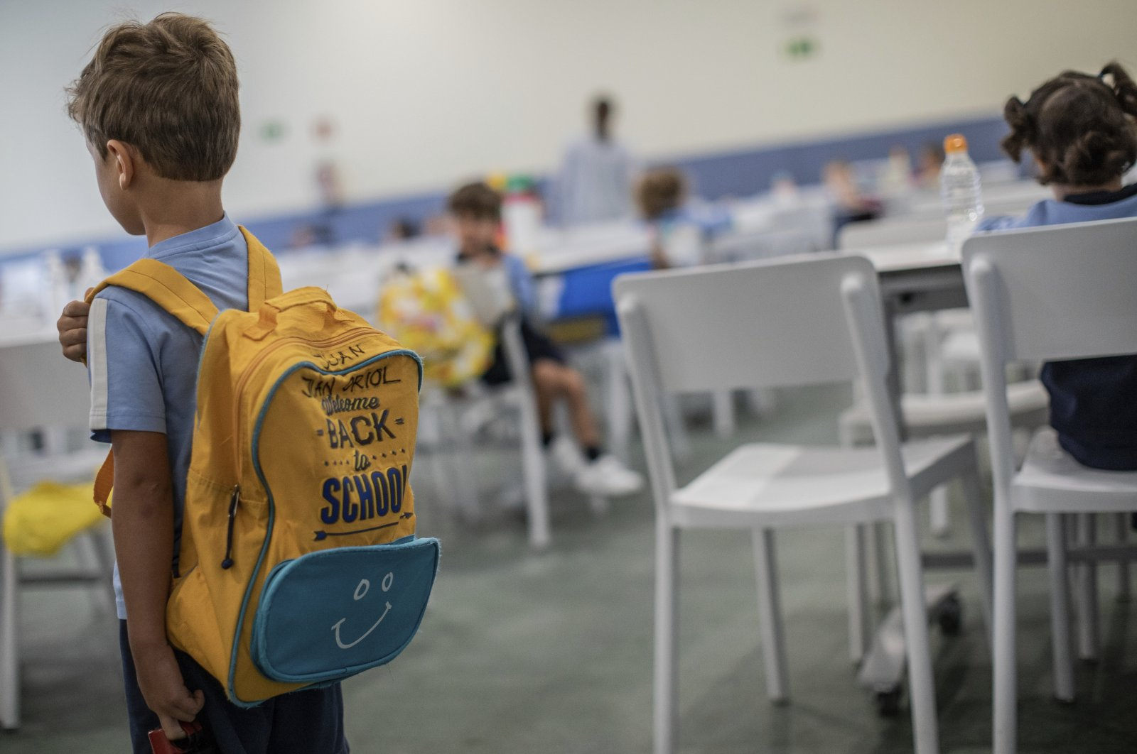 A pupil arrives at the J.H. Newman College International in Madrid, Spain, Sept. 8, 2020. (AP Photo)