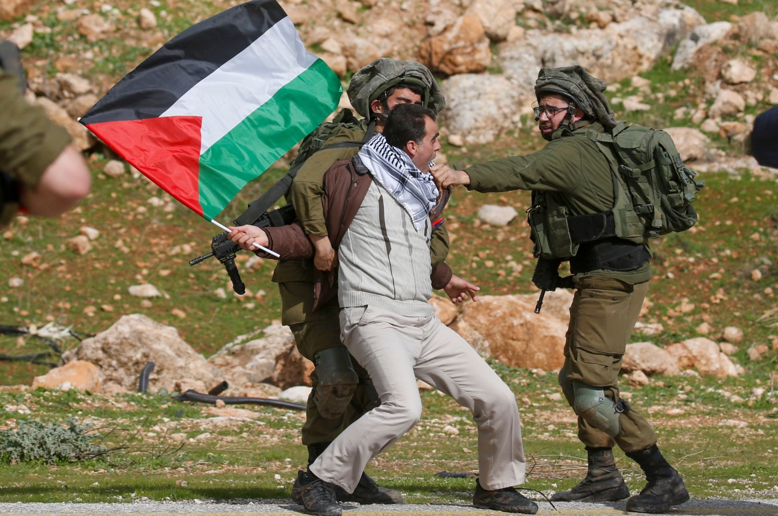 A Palestinian demonstrator is detained by Israeli soldiers during a demonstration near the West Bank village of Tubas, near the Jordan Valley, on Jan. 29, 2020. (AFP Photo)