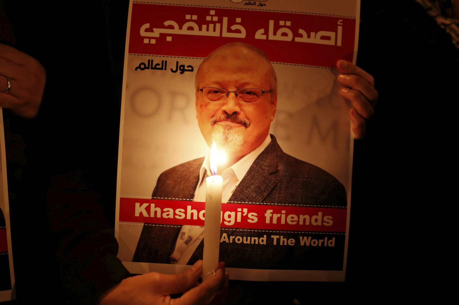 A demonstrator holds a poster with a picture of slain Saudi journalist Jamal Khashoggi outside the Saudi Arabia Consulate, Istanbul, Oct. 25, 2018. (REUTERS Photo)
