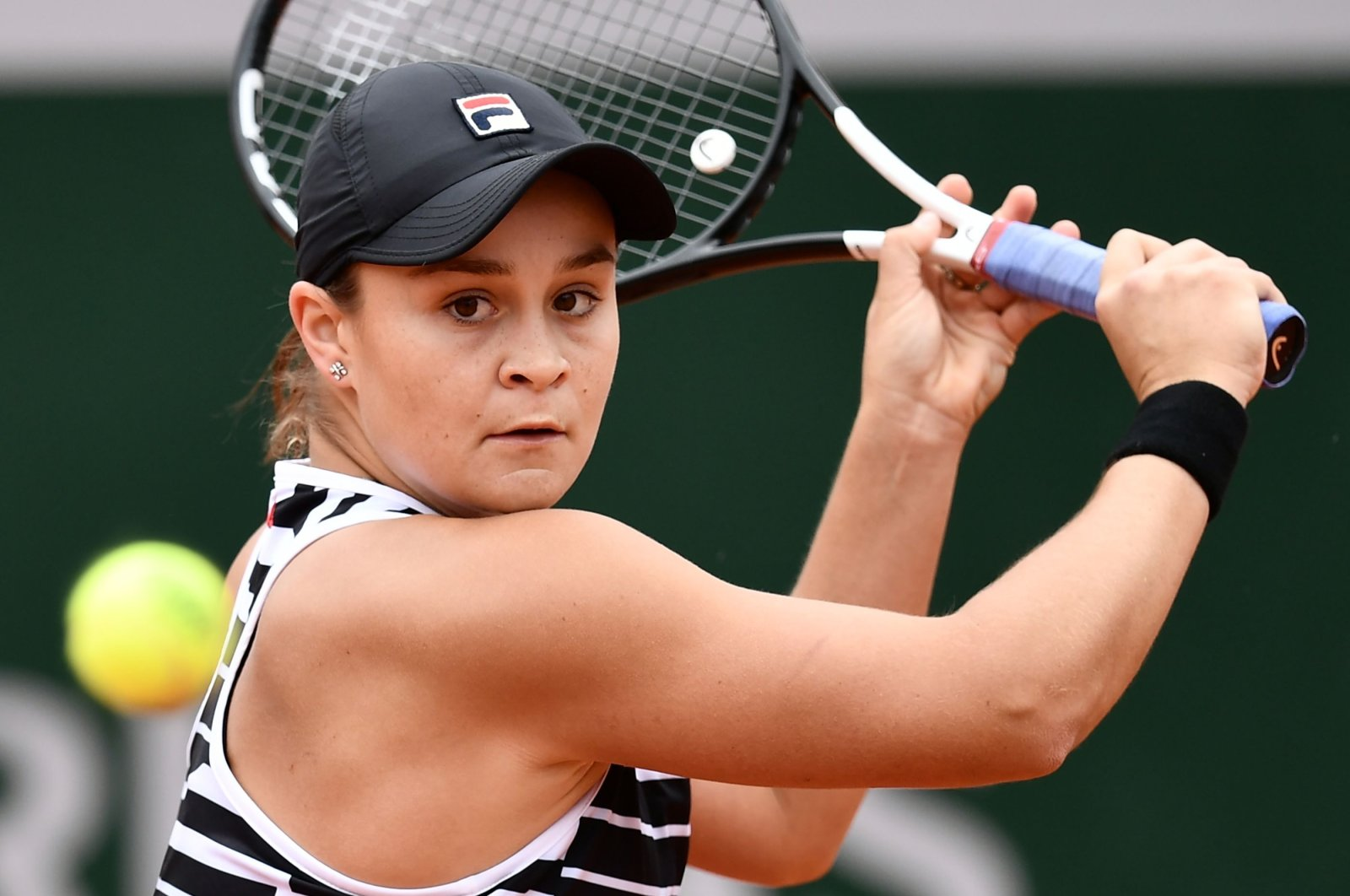 Ashleigh Barty hits a return during a women's semifinal match at the French Open tennis tournament in Paris, France, June 7, 2019. (AFP Photo)