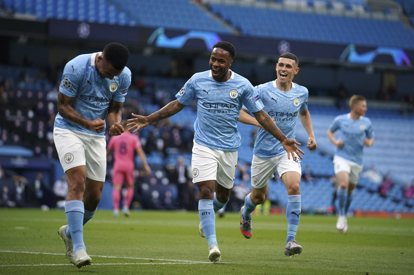 Manchester City's Raheem Sterling (C) celebrates after scoring a goal during a Champions League match against Real Madrid, in Manchester, England, Aug. 7, 2020. (AP Photo)