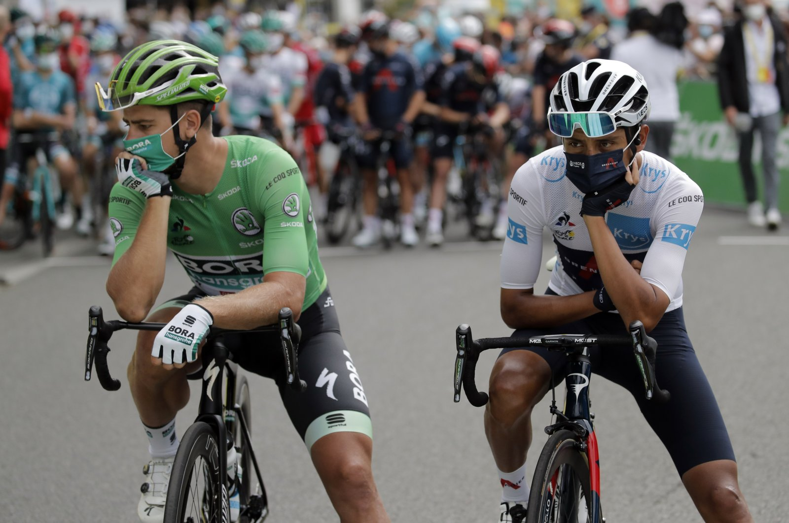 Colombia's Egan Bernal (R) and Slovakia's Peter Sagan wait prior to the start line of the ninth stage of the Tour de France cycling race in Pau, France, Sept. 6, 2020. (AP Photo)