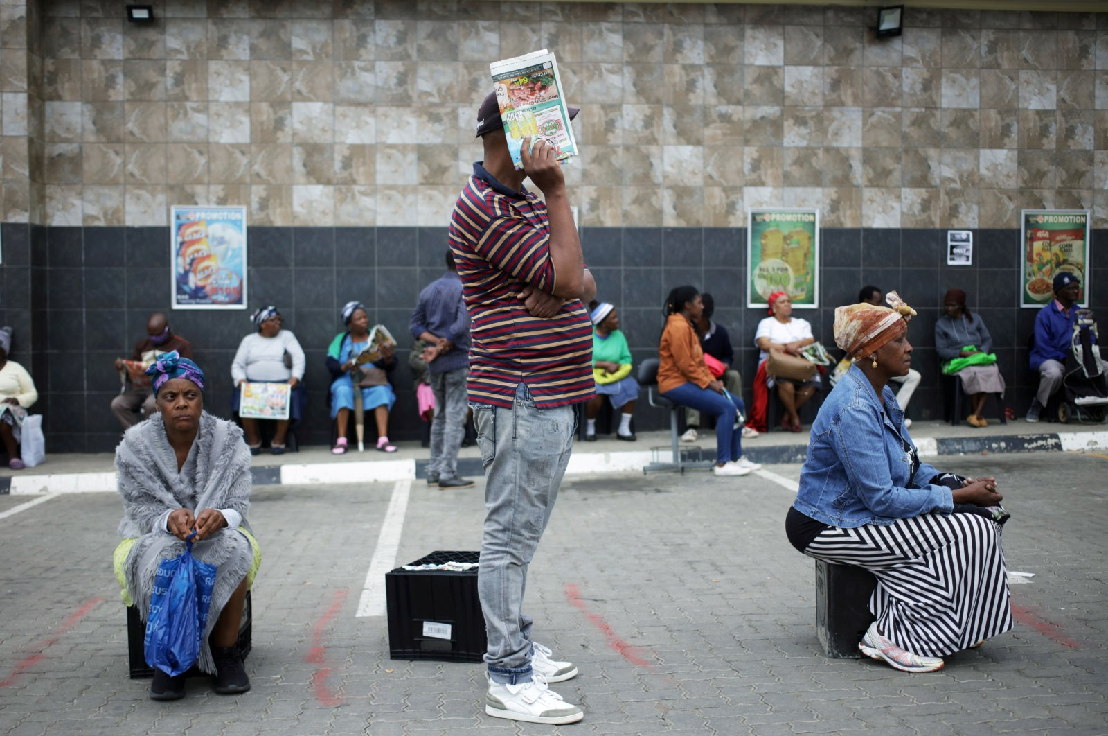 Shoppers queue in line with social distance rules during a 21-day nationwide COVID-19 lockdown in Soweto, South Africa, March 30, 2020. (Reuters Photo)
