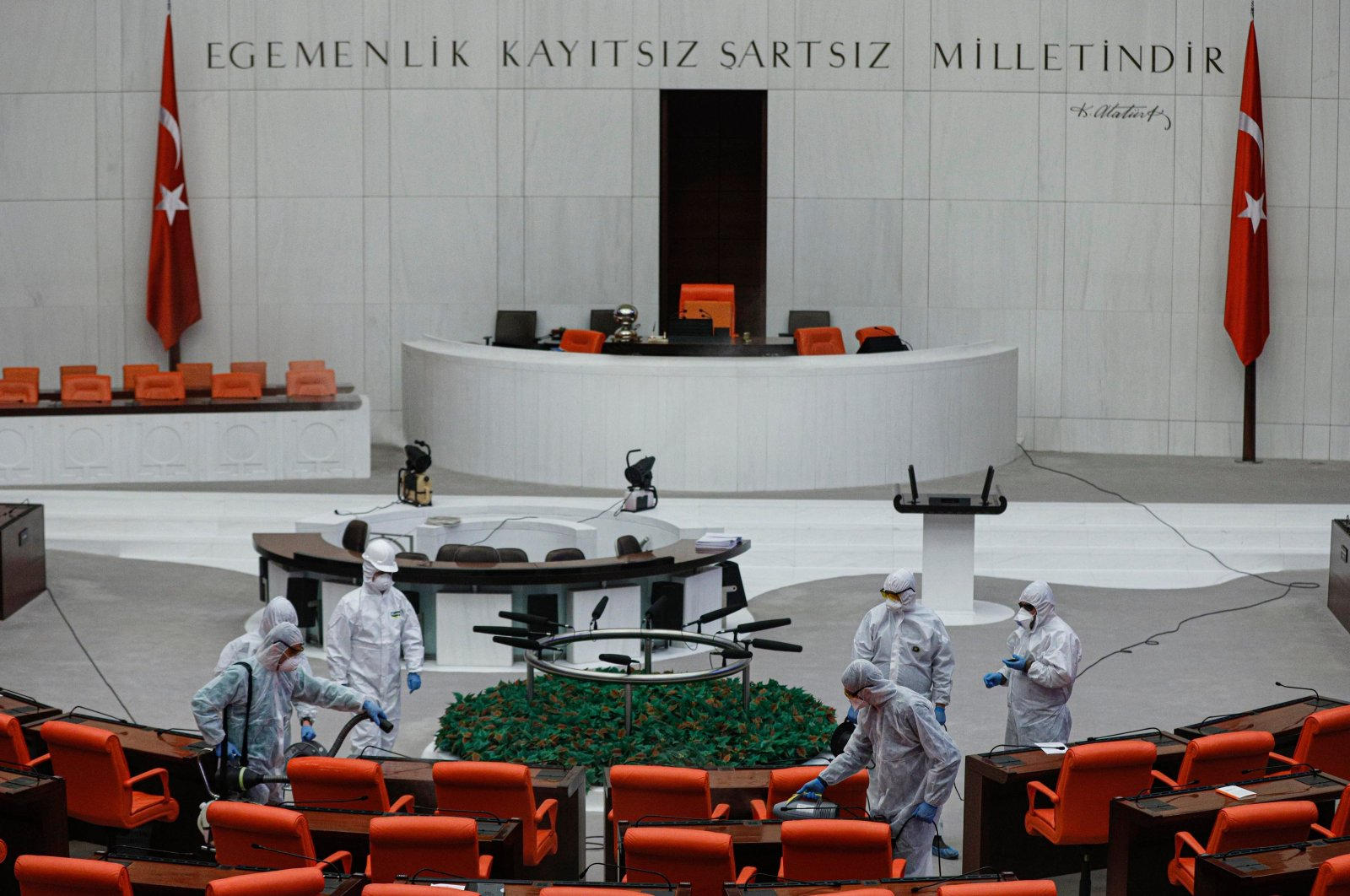 Workers disinfect the General Assembly at the Grand National Assembly of Turkey on Tuesday, March 17, 2020. (DHA Photo)