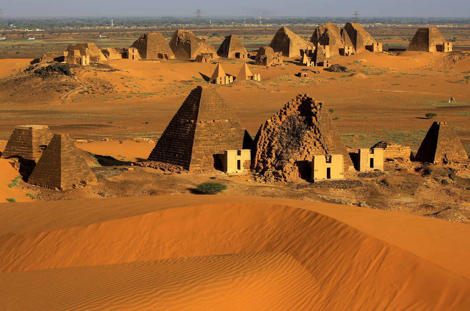 Creeping desert sands surround the Royal Cemeteries of the Meroe Pyramids in Begrawiya, River Nile state, Sudan, Nov. 10, 2019. (Reuters Photo)