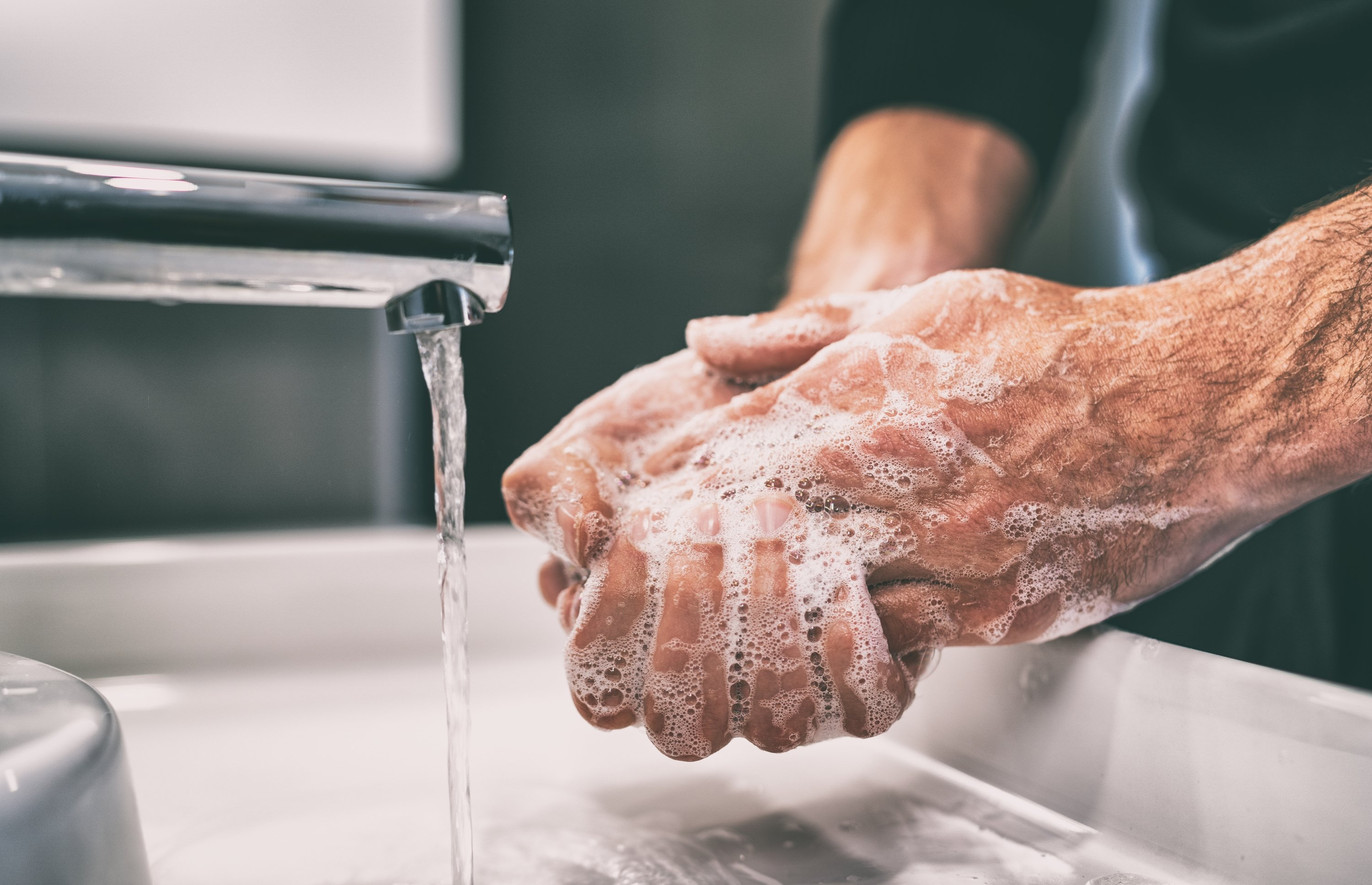 When washing your hands, make sure you get the underside of your nails too. (Shutterstock Photo)