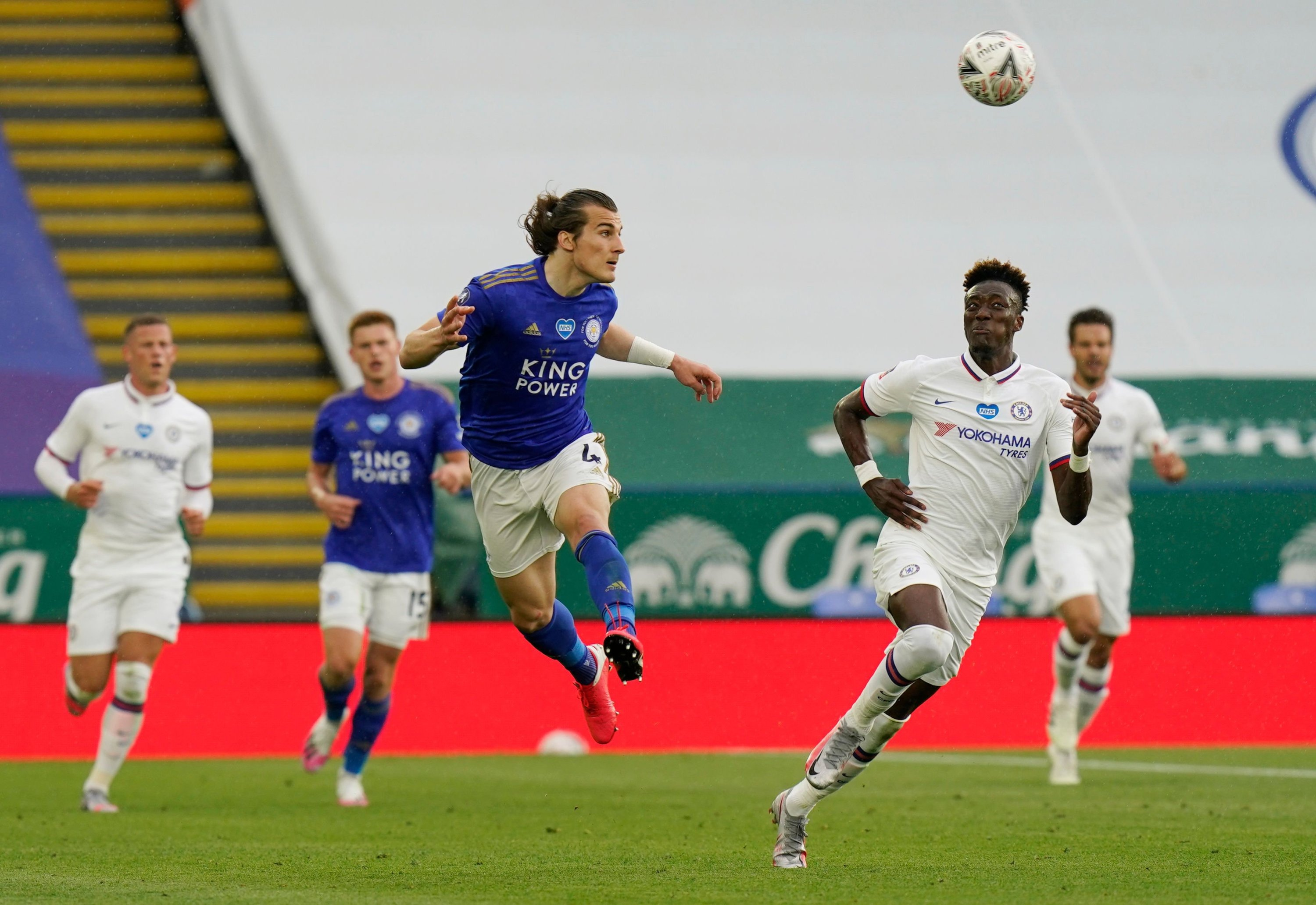 Leicester City's Çağlar Söyüncü in action with Chelsea's Tammy Abraham, at King Power Stadium, Leicester, the U.K., June 28, 2020. (Reuters Photo)