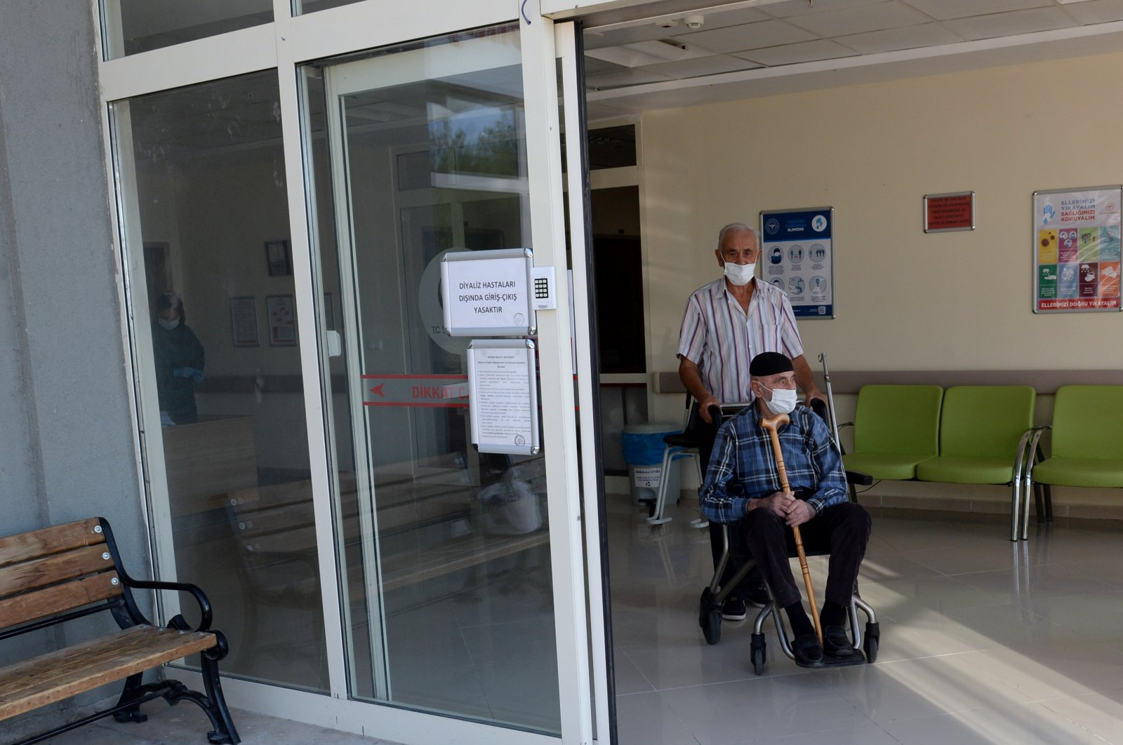 Kurteş Sap (standing) and his dad Şaban Sap leave the hospital after testing negative for COVID-19, in Tokat province's Niksar district, northern Turkey, Sept. 8, 2020. (AA Photo)