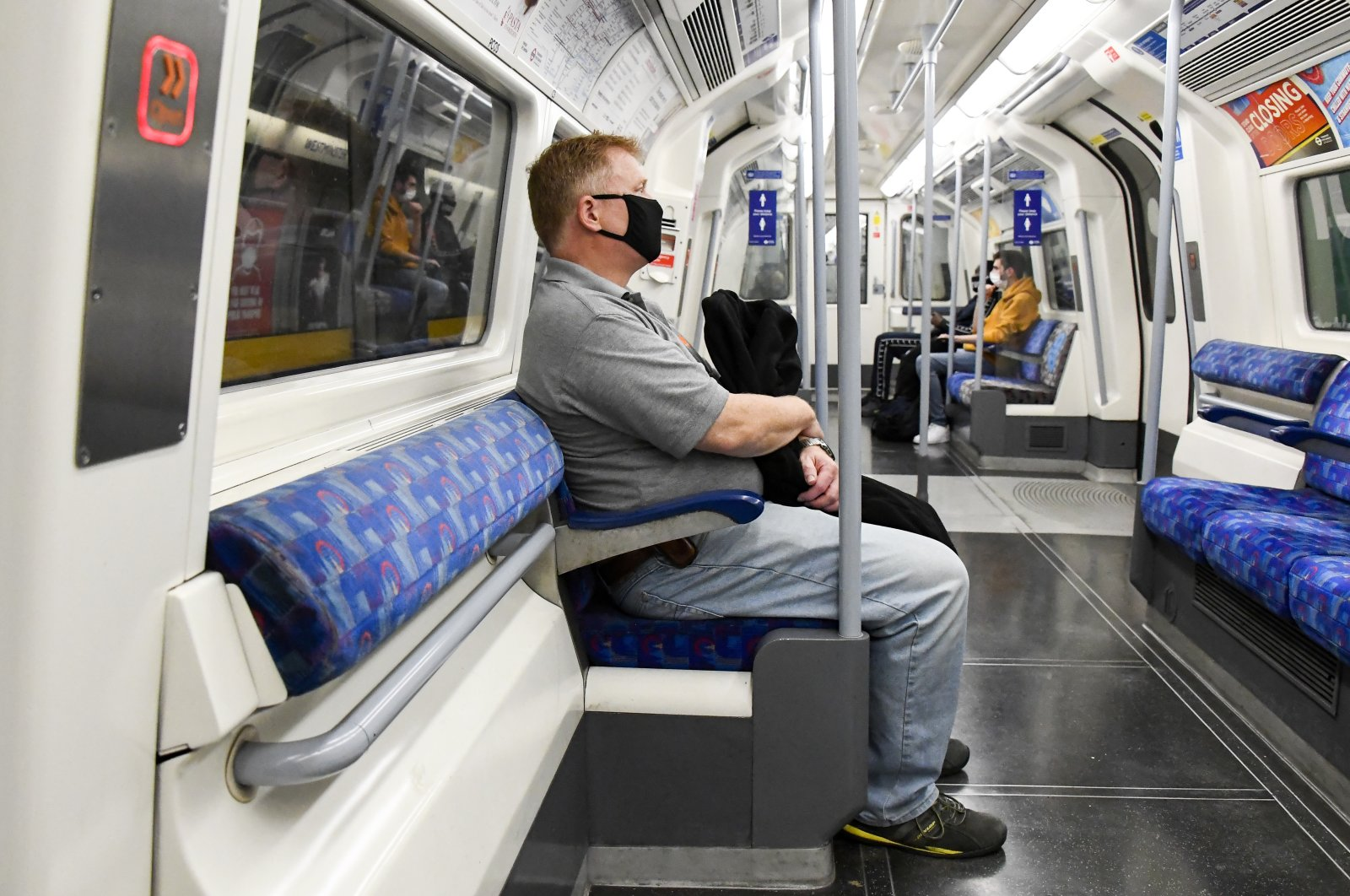 A man wears a face mask as he sits in an underground train, London, Sept. 8, 2020. (AP Photo)