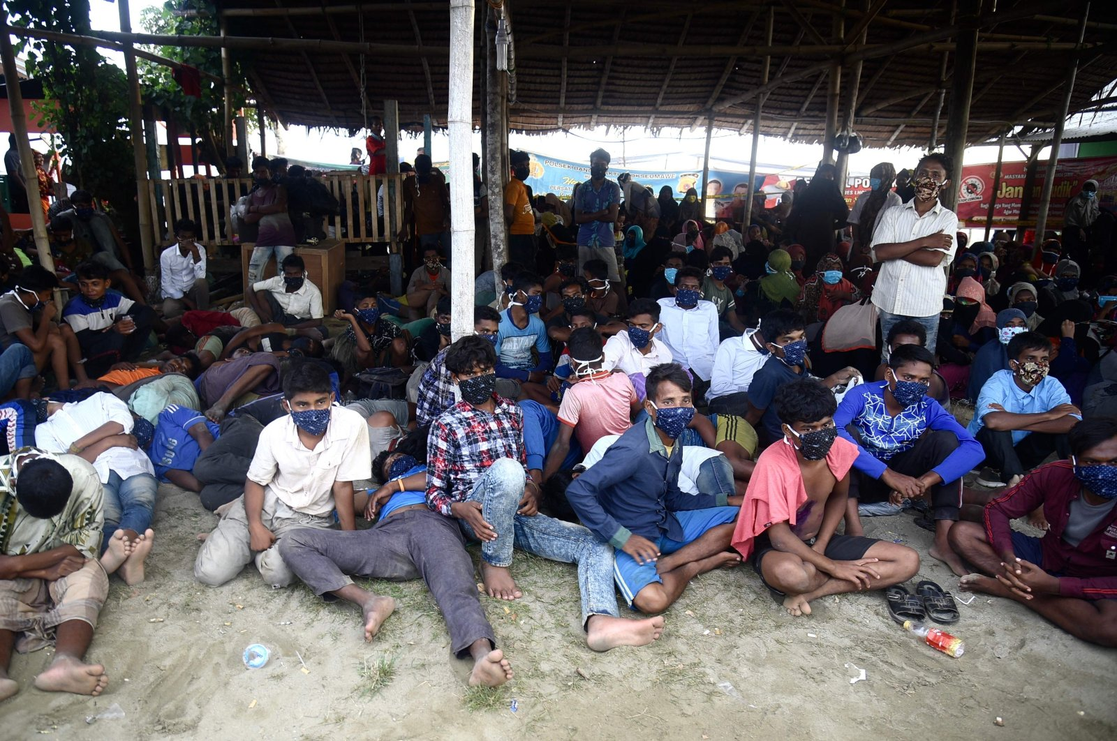 Rohingya migrants rest after their arrival by boat in Lhokseumawe, Sumatra, Indonesia, Sept. 7, 2020. (AFP Photo)
