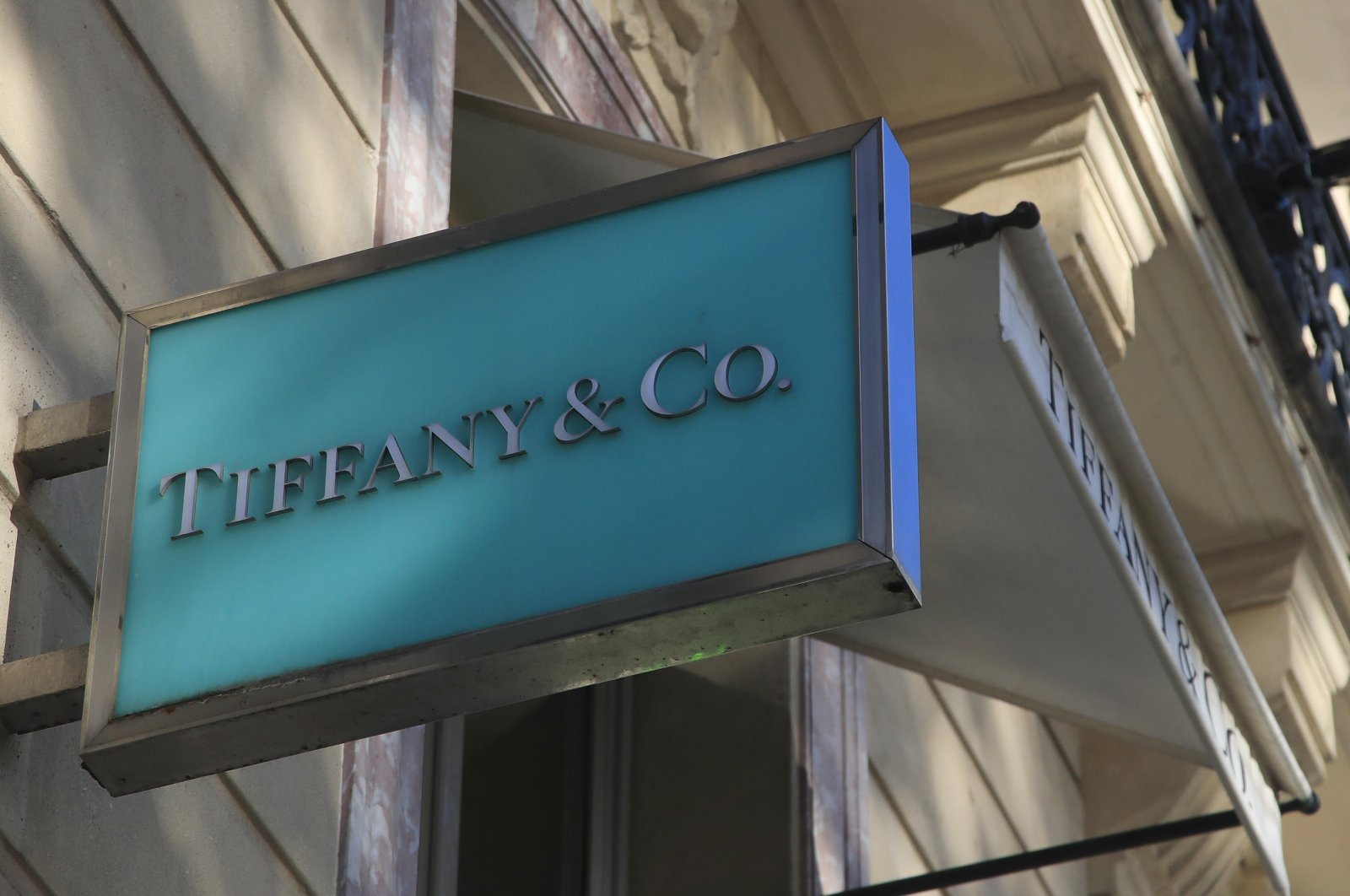 The Tiffany's logo on the Champs Elysees avenue in Paris, Nov. 25, 2019. (AP Photo)