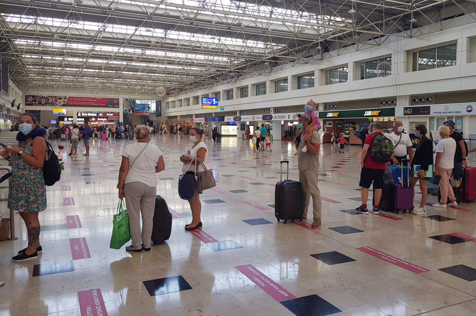 Tourists seen in a line at the Antalya Airport in southern Antalya, Turkey, Sept. 9, 2020. (DHA Photo)