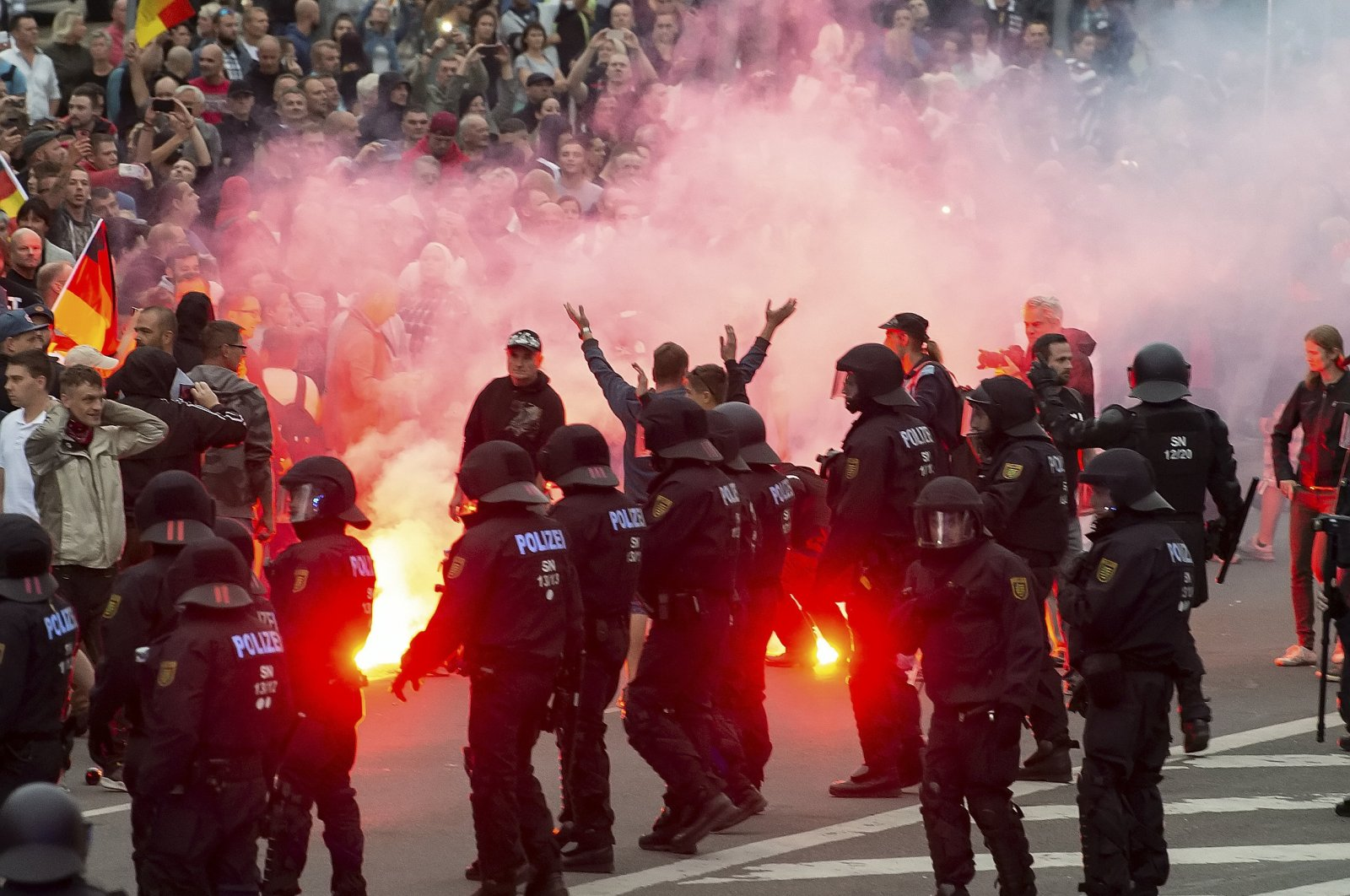 Protesters light fireworks during a far-right protest in Chemnitz, Germany, Aug. 27, 2018. (AP Photo)