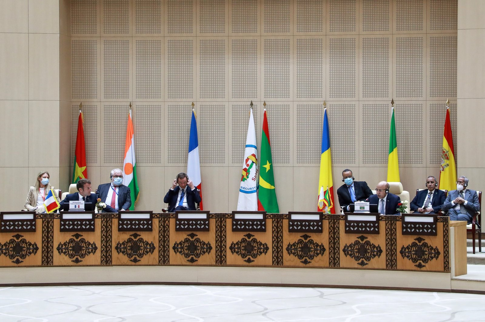 French President Emmanuel Macron listens as Mauritanian President Mohamed Ould Cheikh El Ghazouani speaks during the G5 Sahel summit in Nouakchott, Mauritania, June 30, 2020. (Reuters Photo)