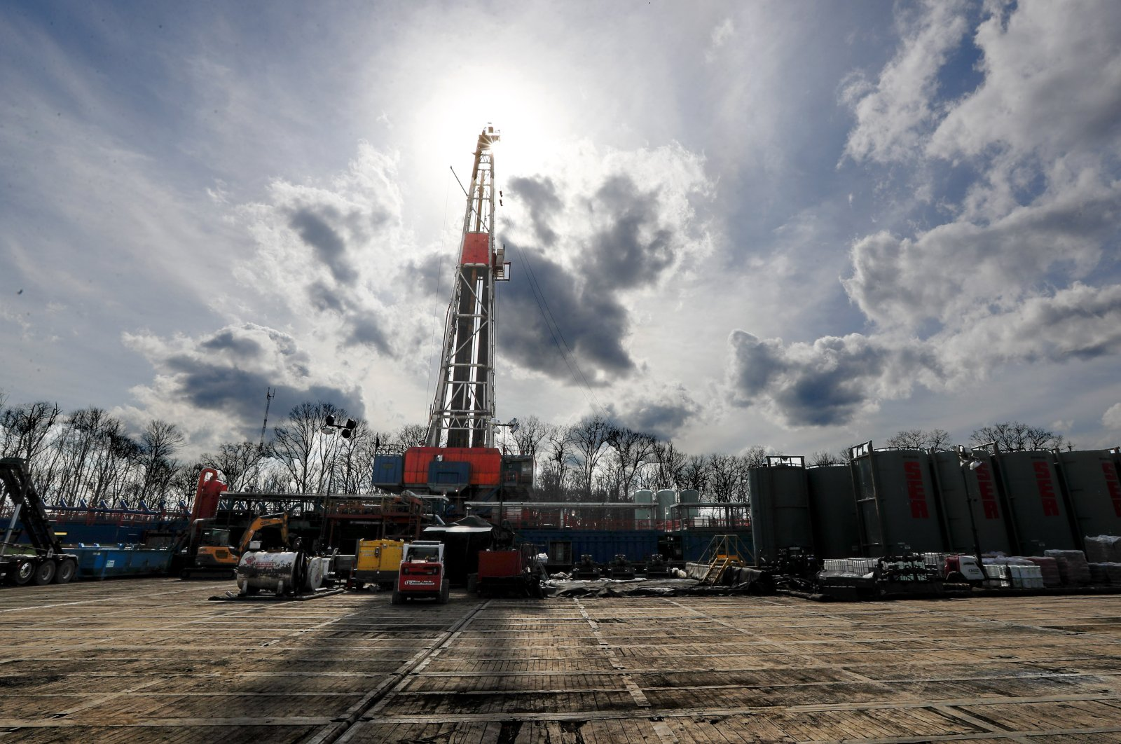 The sun shines through clouds above a shale gas drilling site in St. Mary's, Pennsylvania, March 12, 2020. (AP Photo)