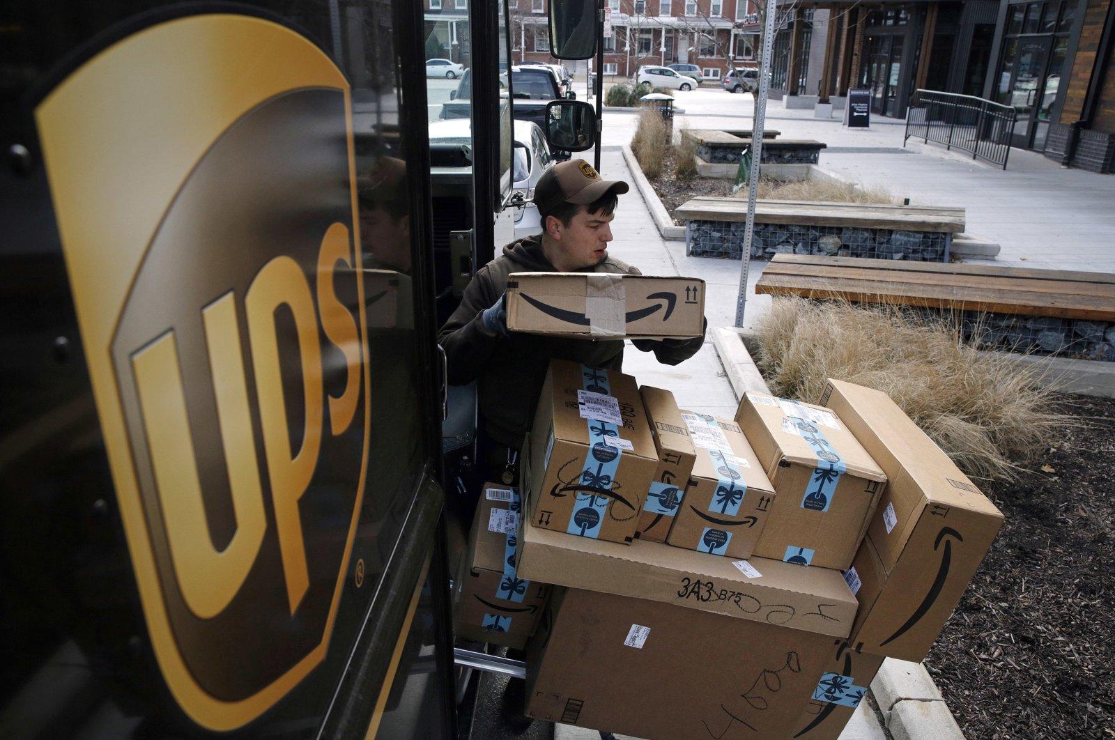A UPS driver prepares to deliver packages, Dec. 19, 2018. (AP Photo)