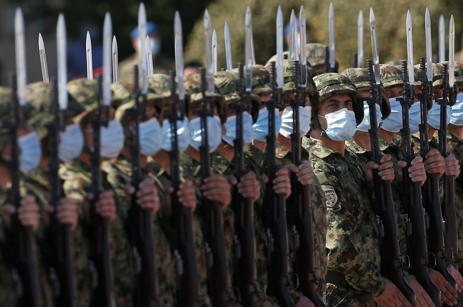 Serbian Honor guard wearing protective face masks during a welcome ceremony for Serbian President Aleksandar Vucic before the military exercises on Batajnica, military airport near Belgrade, Serbia on Aug. 21, 2020. (AP Photo)