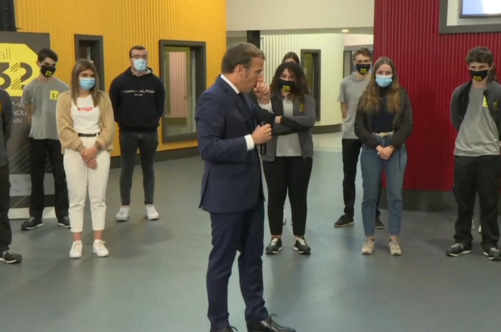 Screenshot from footage shows French President Emmanuel Macron coughing on his hand during his speech to students of a vocational school in Clermont-Ferrand, France, Sept. 8, 2020.