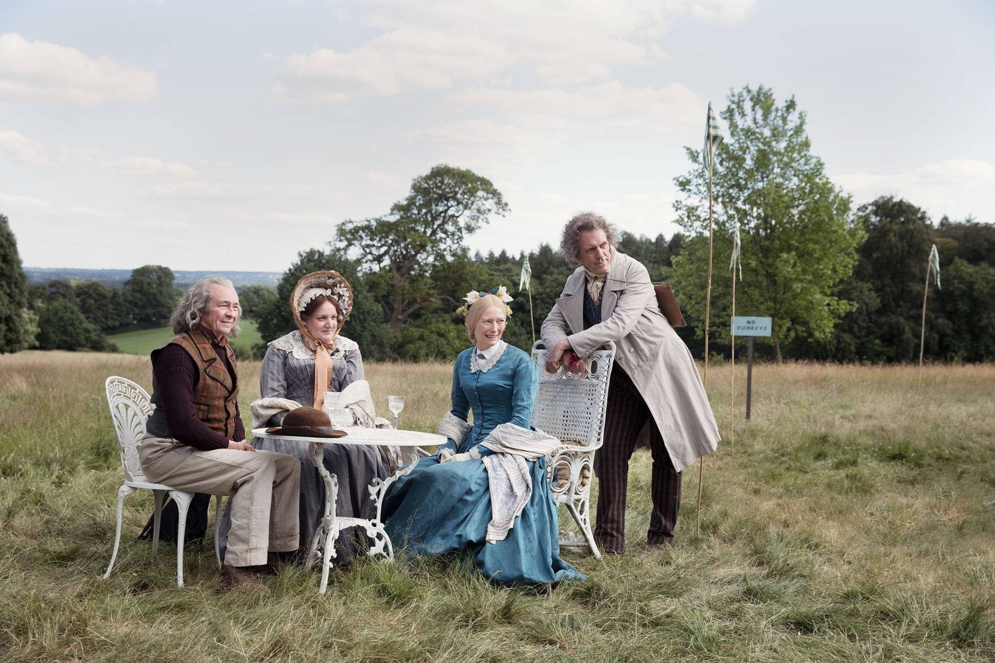 From left: Paul Whitehouse, Daisy May Cooper, Tilda Swinton and Peter Capaldi are seen in Victorian clothes in the movie.