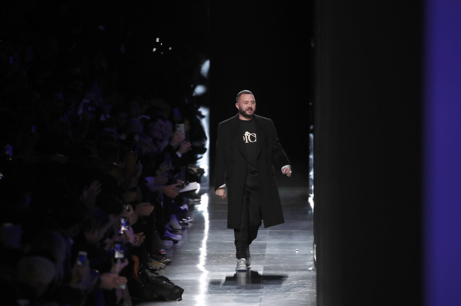 Designer Kim Jones accepts applause after the Dior Homme Men's Fall/Winter 2020-2021 fashion collection was presented in Paris, France, Jan. 17, 2020. (AP Photo)