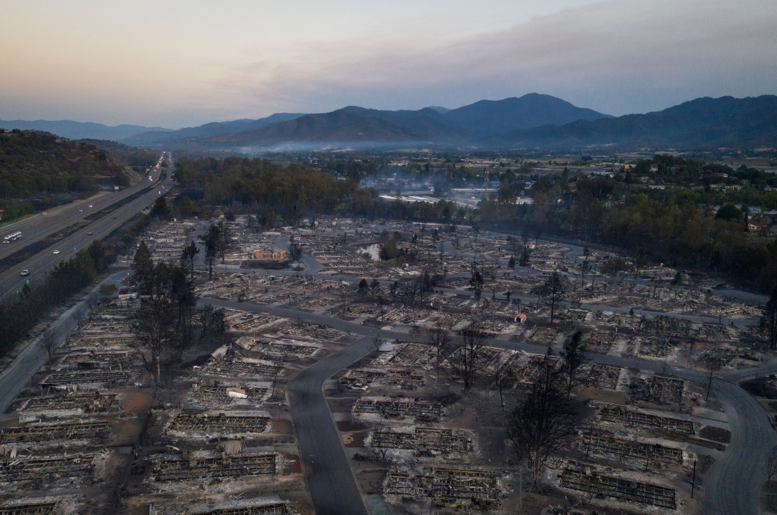 Interstate 5 is seen on the left as the Bear Lakes Estates neighborhood is left devastated in the aftermath of the Almeda fire in Phoenix, Oregon, Sept. 9, 2020. (Reuters Photo)