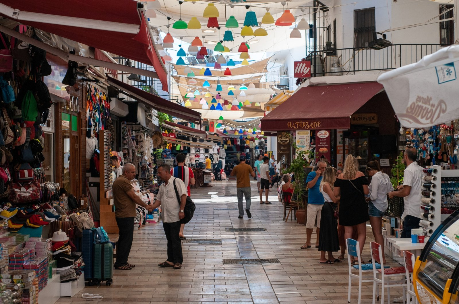 People and locals walk and shop on a shopping street near the promenade of Bodrum, August 23, 2019. (iStock Photo)