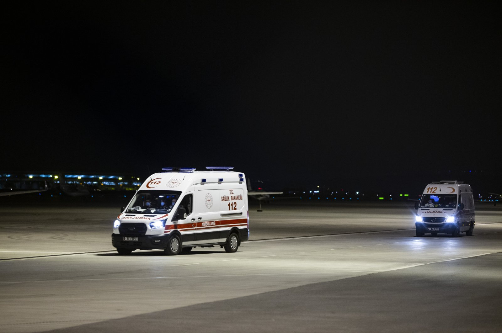 Ambulances carry patients arriving from the Turkish Republic of Northern Cyprus (TRNC), at Esenboğa Airport, in the capital Ankara, Turkey, Sept. 9, 2020. (AA Photo)