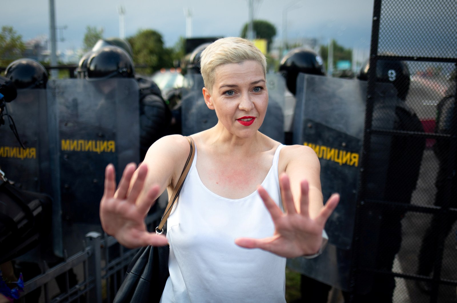 Belarusian opposition politician Maria Kolesnikova gestures in front of law enforcement officers during a rally in Minsk, Belarus, Aug. 30, 2020.  (Reuters Photo)
