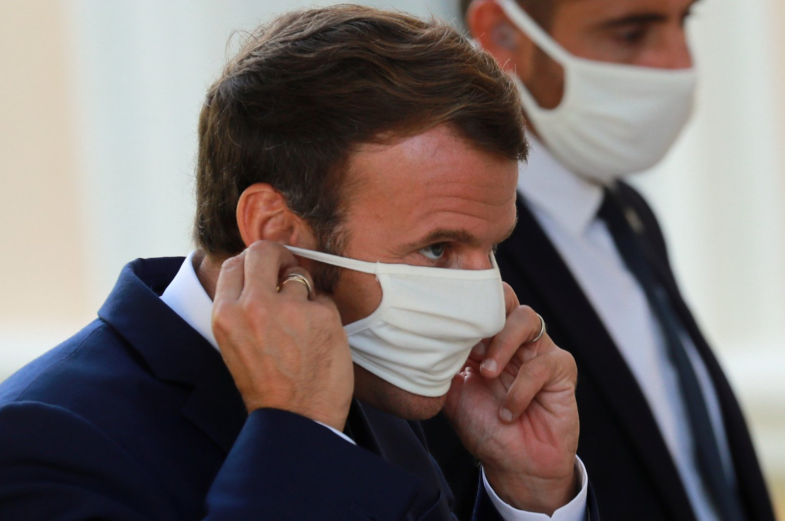 French President Emmanuel Macron puts on his protective mask as he arrives for a news conference in Ajaccio, on the Mediterranean island of Corsica, France, Sept. 10, 2020. (REUTERS Photo)
