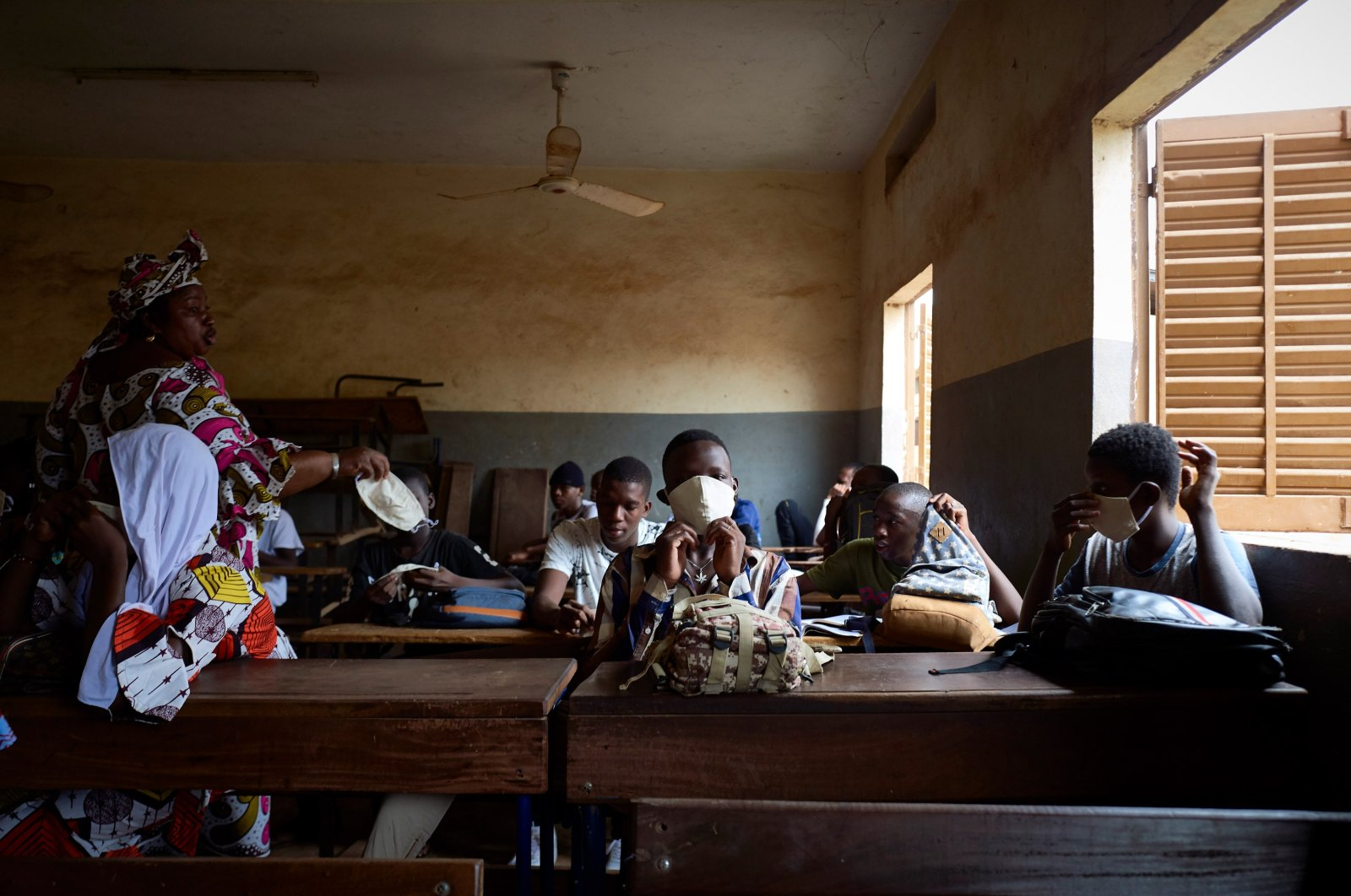 Malian students attend a lesson as the government decided to reopen the schools after two months of closure due to the spread of COVID-19 coronavirus, in Mali's capital Bamako, June 2, 2020. (AFP Photo)