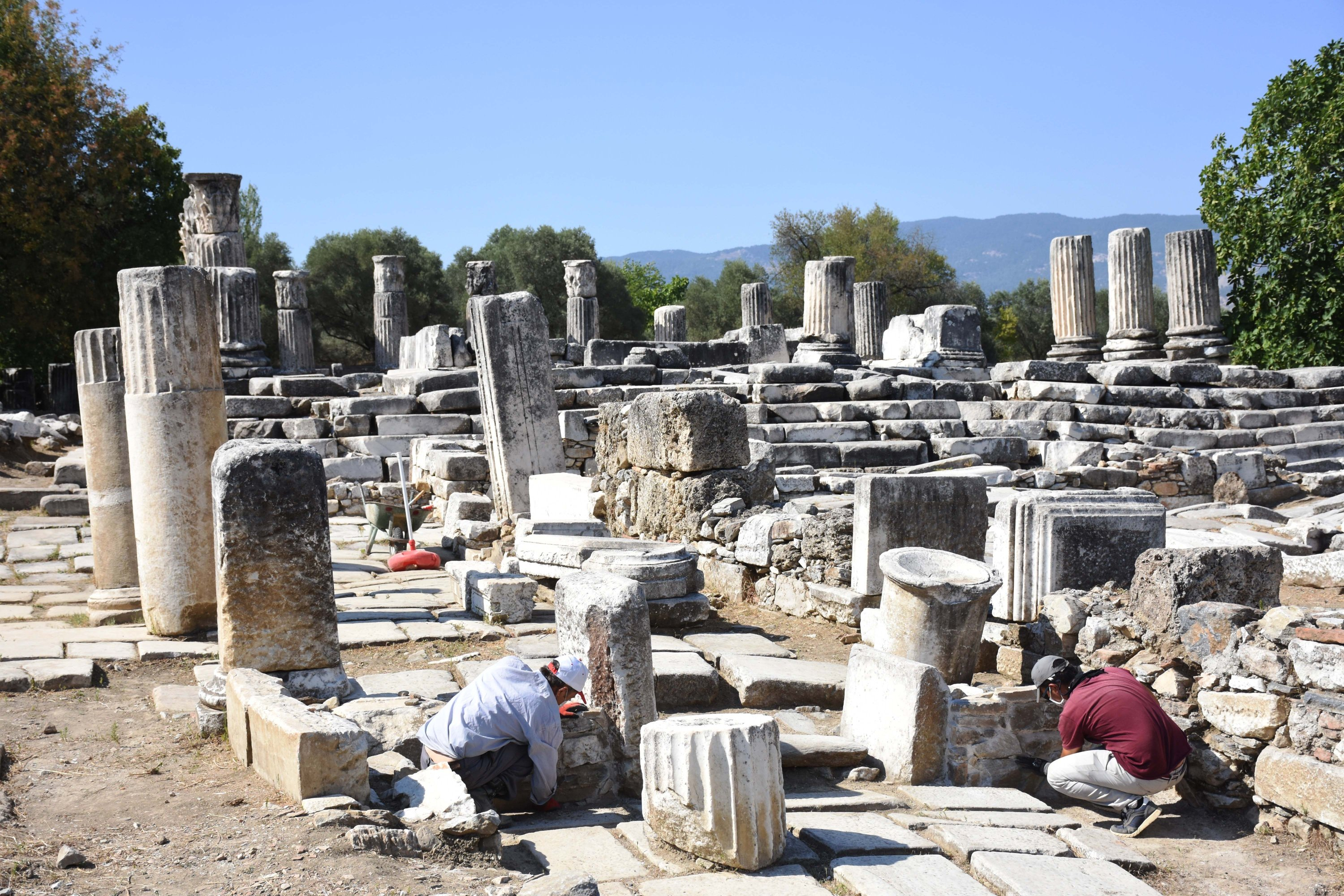 Archaeologists work on historical columns at the Sanctuary of Hecate in Lagina, Muğla province, southwestern Turkey, Sept. 7, 2020. (AA Photo)