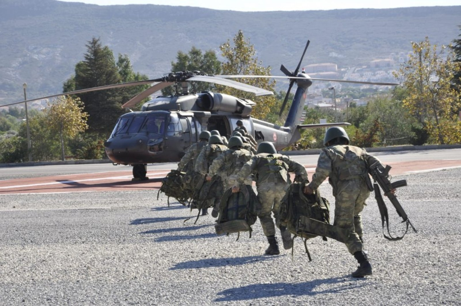 Gendarmerie special forces are seen walking toward a military helicopter as the Interior Ministry launches Operation Lightning-10 against terrorists in eastern Van province, Turkey, Sept. 8, 2020. (AA Photo)