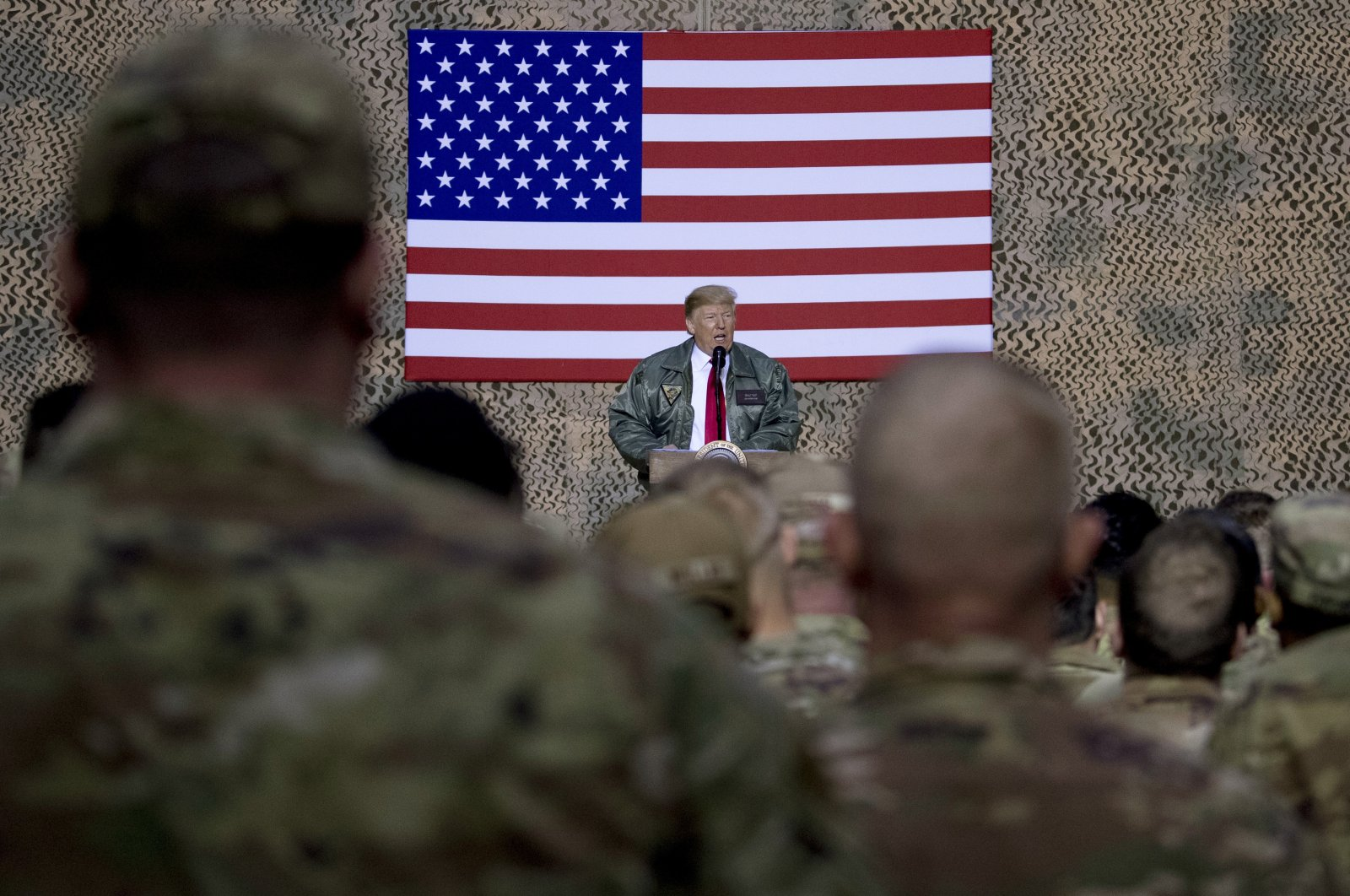 U.S. President Donald Trump speaks to members of the military at a hangar rally at al-Asad Air Base, Iraq, Dec. 26, 2018. (AP Photo)