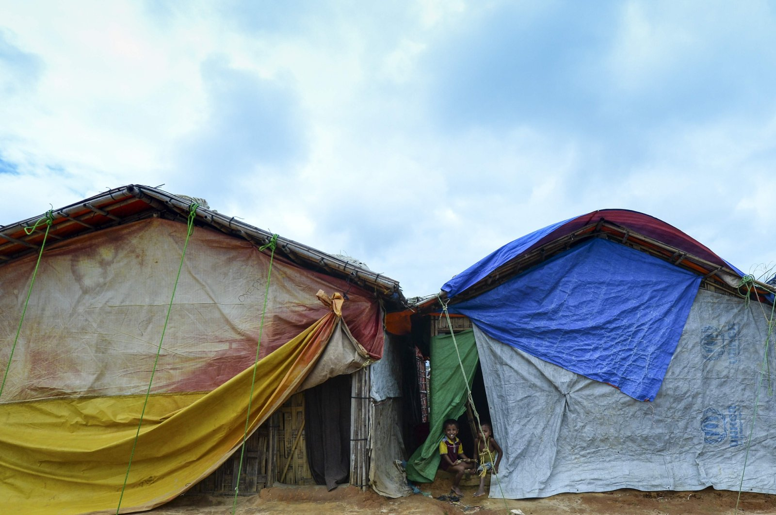 Rohingya children play in front of their makeshift home at Kutupalong refugee camp in Ukhia, Cox's Bazar, Bangladesh, July 24, 2019. (AFP Photo)