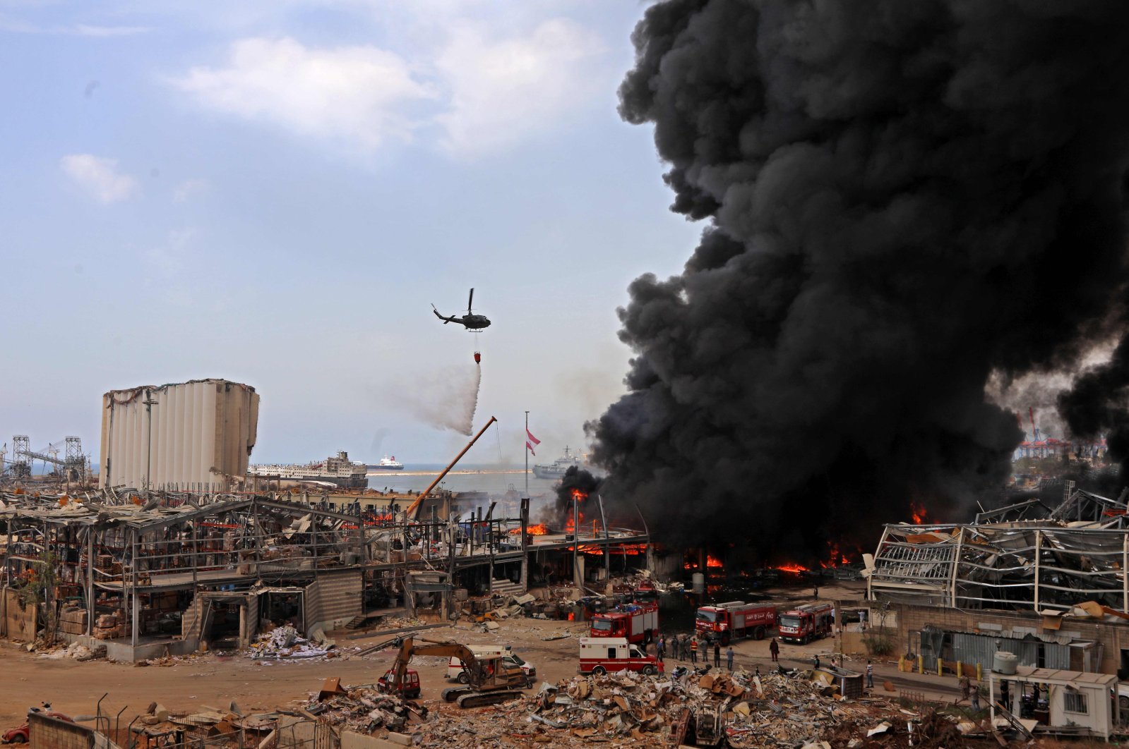 Lebanese firefighters try to put out a fire that broke out at Beirut's port area, on September 10, 2020. (AFP Photo)