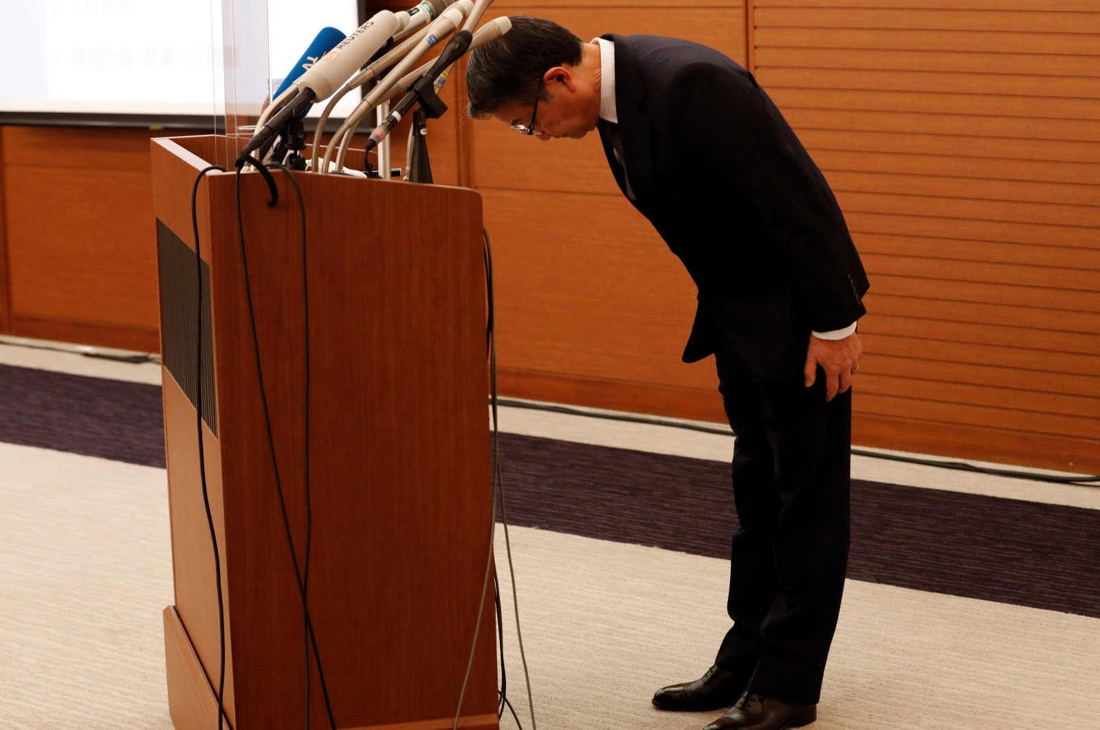 Mitsui O.S.K. Lines President and Chief Executive Officer (CEO) Junichiro Ikeda bows his head to apologize during a news conference about its measures to help recover environment and provide contributions to local communities after the MV Wakashio, chartered by the shipping company, ran aground on a reef in Mauritius in July, at his headquarters in Tokyo, Japan September 11, 2020. (Reuters Photo)